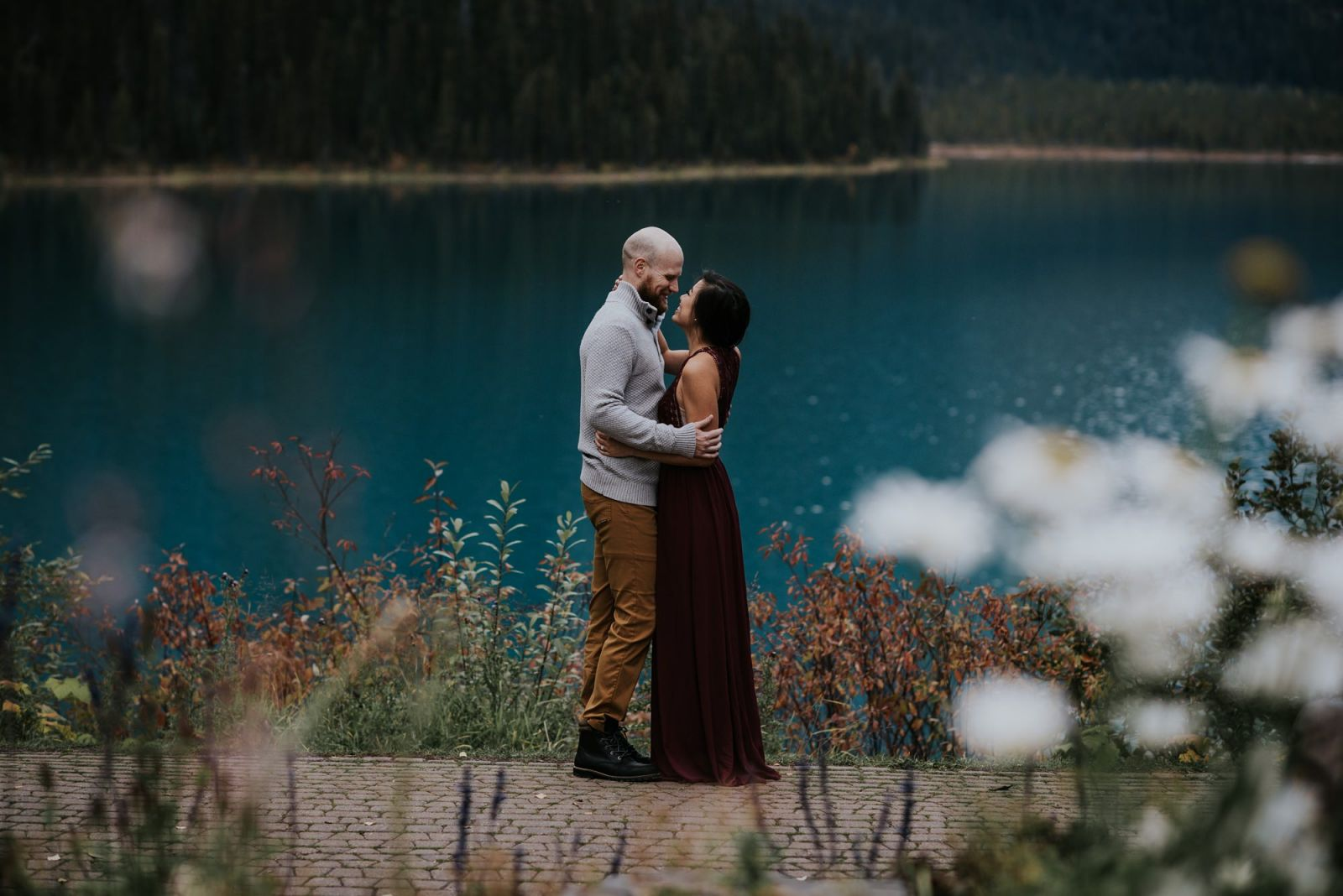 couple with flowers at emerald lake lodge bc by professional engagement photographer