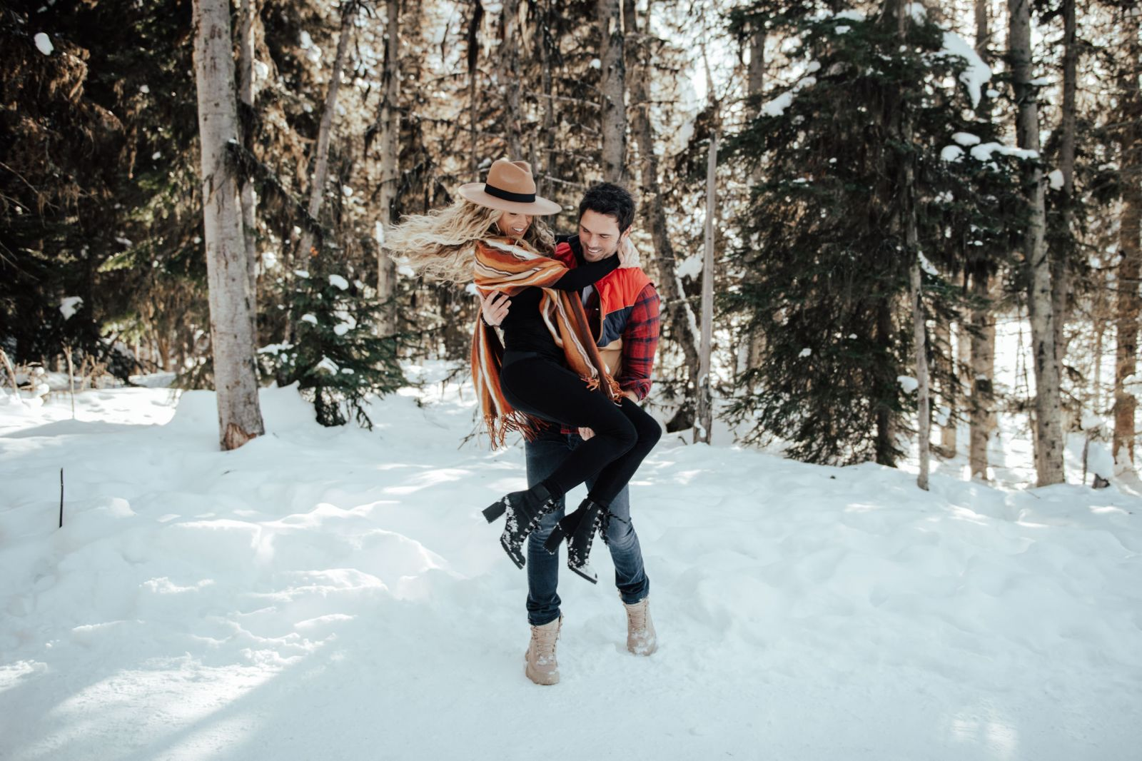 couple dancing in the snow by engagement photographer