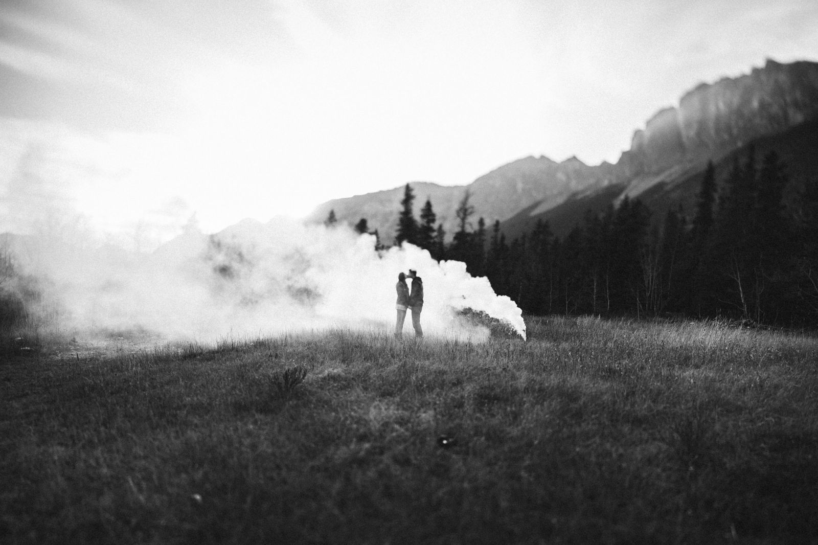 couple and smoke bomb in canmore engagement session