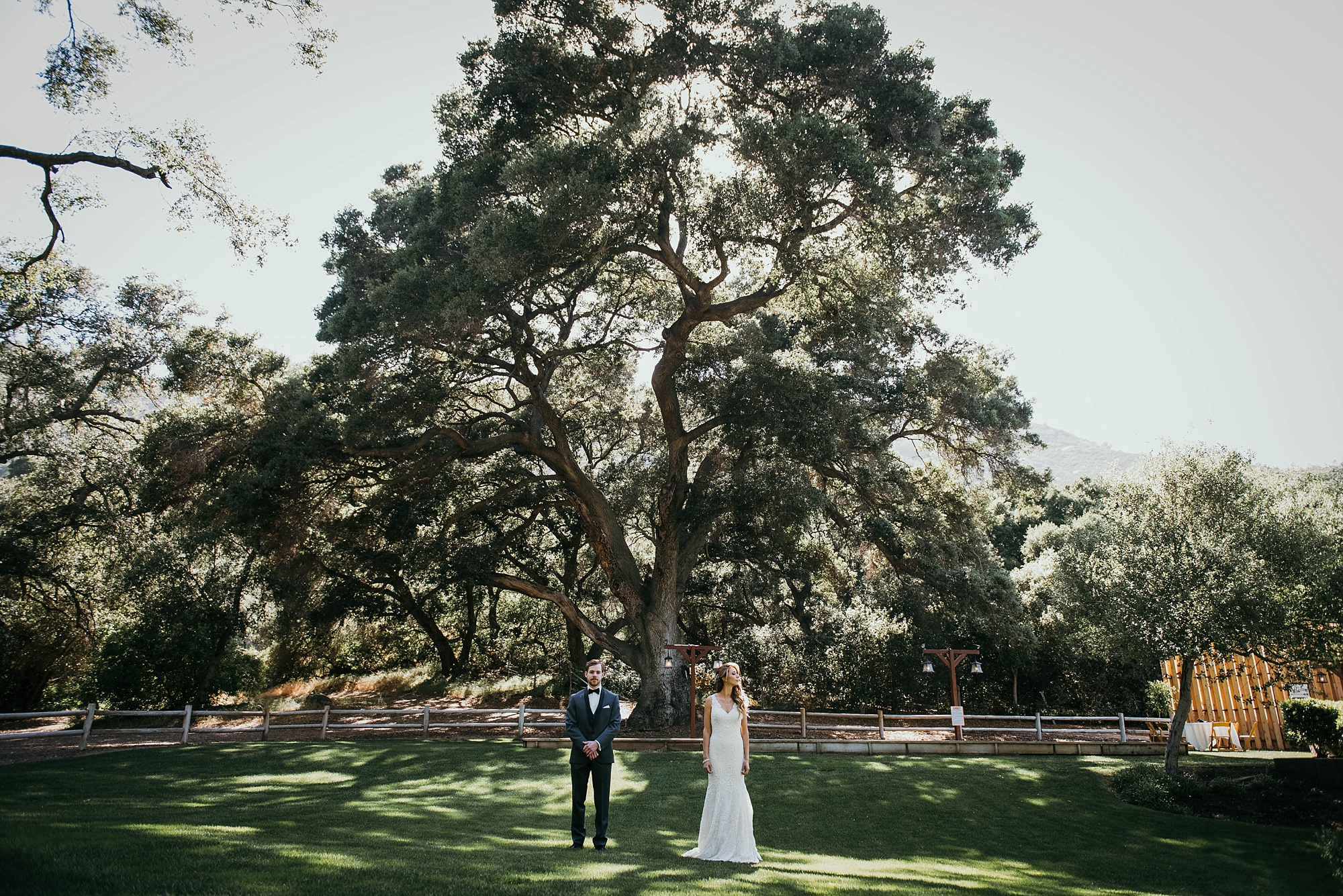 bride and groom standing together at classic and modern Temecula creek inn wedding