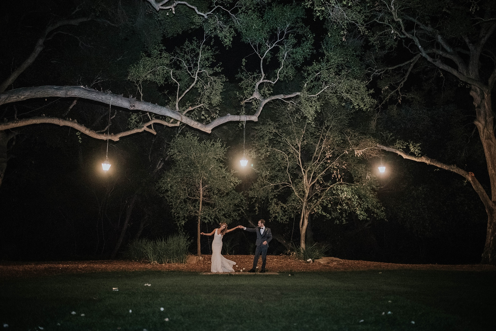 bride and groom dancing under hanging lights in night shot at Temecula creek inn wedding