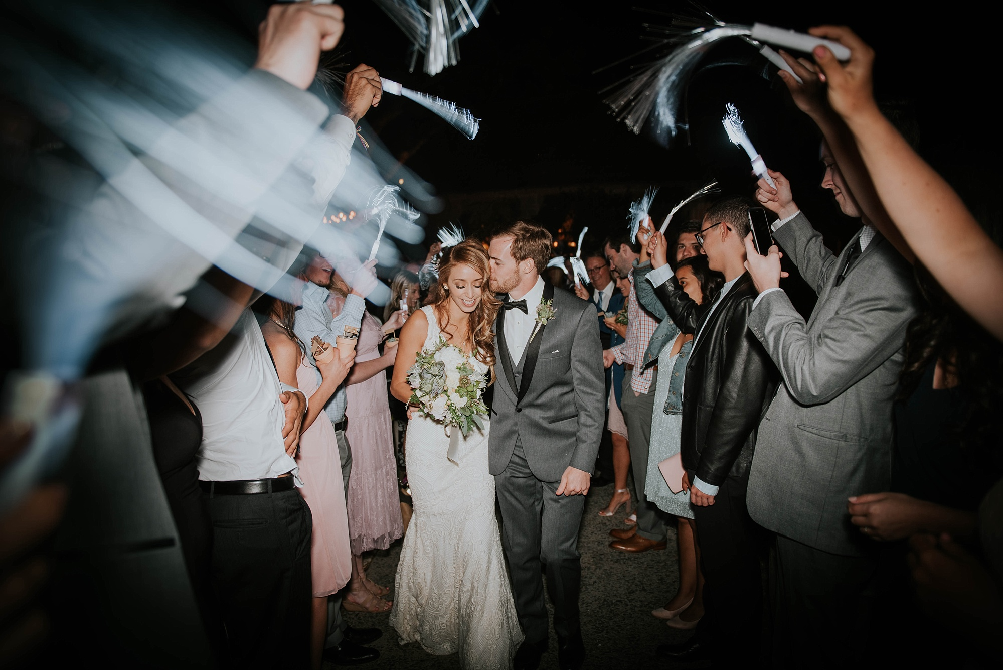 Bride and groom in sparkler exit from Temecula Creek Inn Wedding