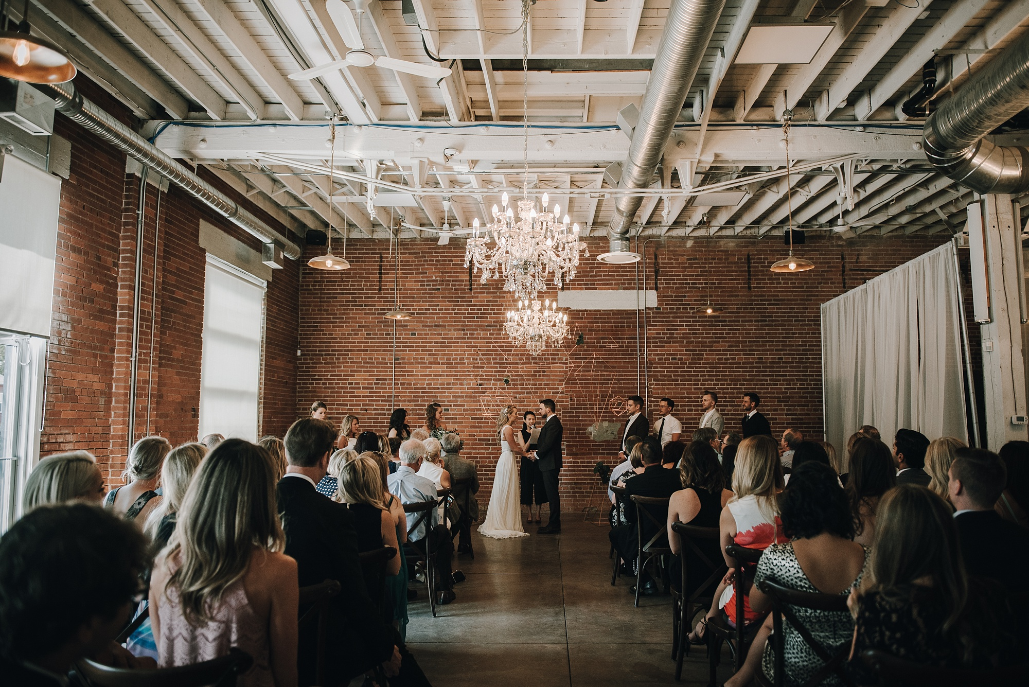 modern industrial wedding at the commons calgary in inglewood