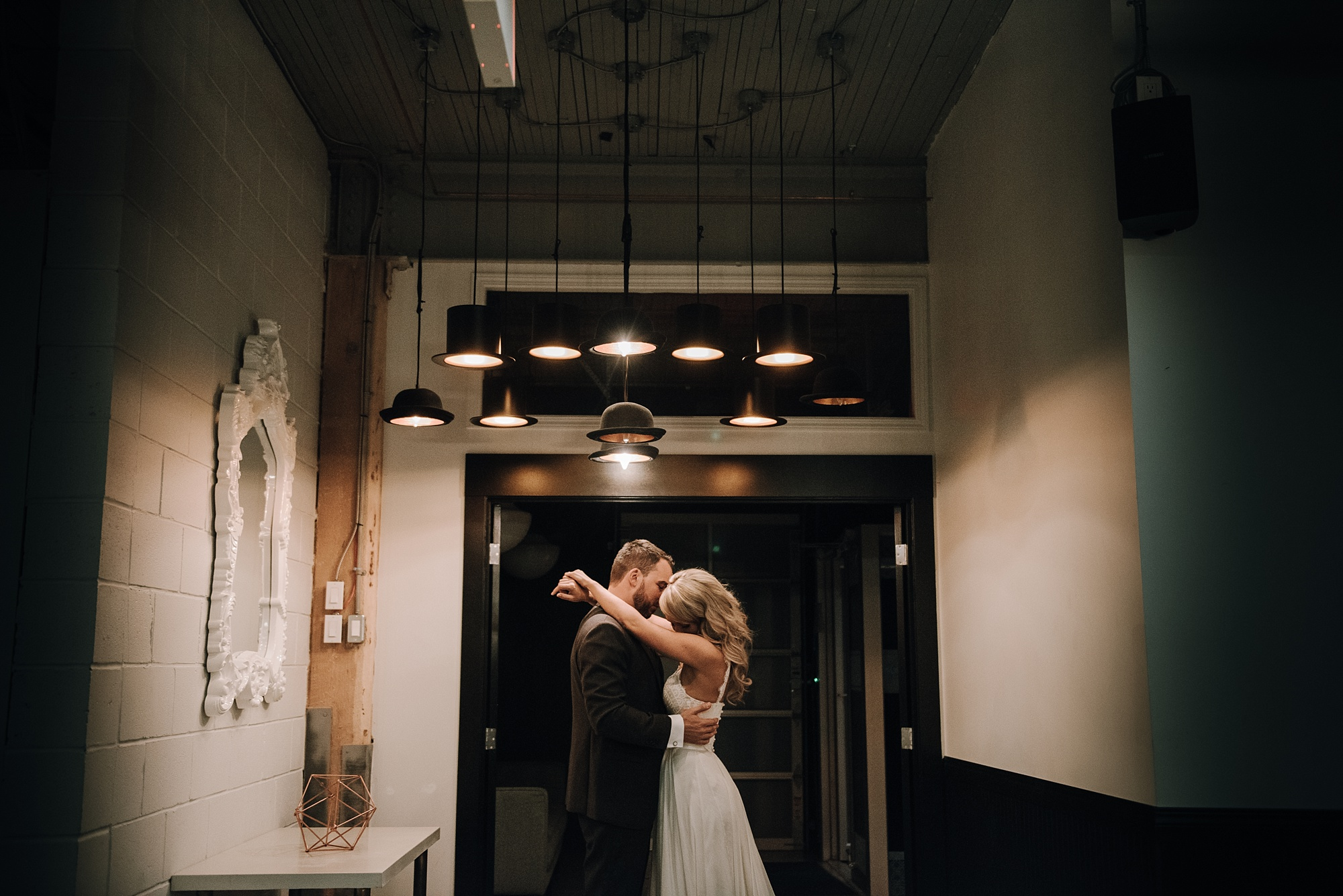 bride and groom underneath artistic lights at the commons calgary wedding