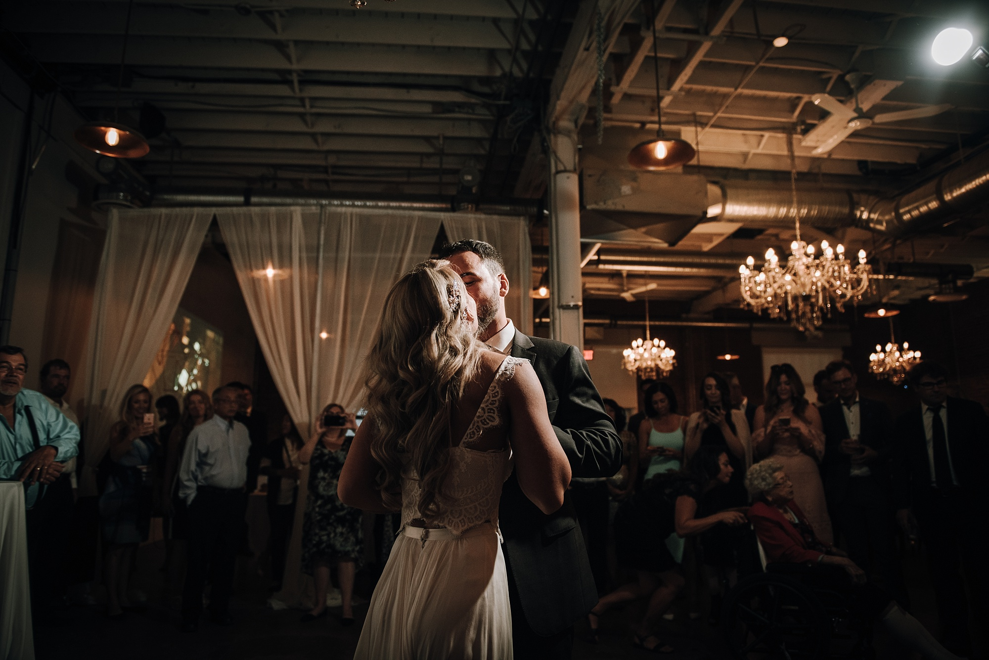 Bride and groom first dance shots in modern industrial calgary wedding