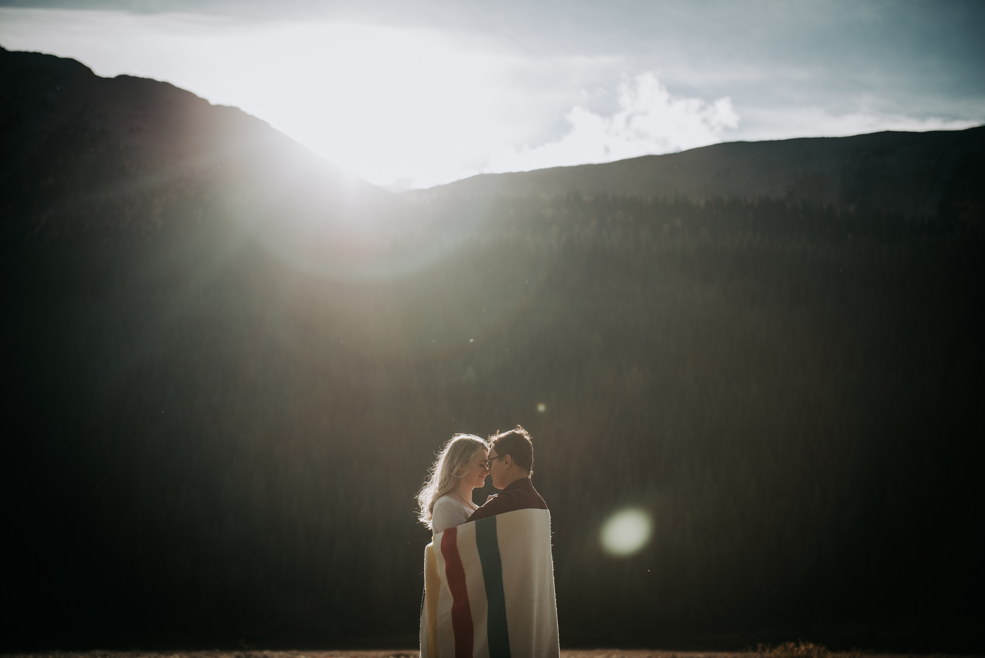 couple embracing tougher with the sunset in Kananaskis photo session