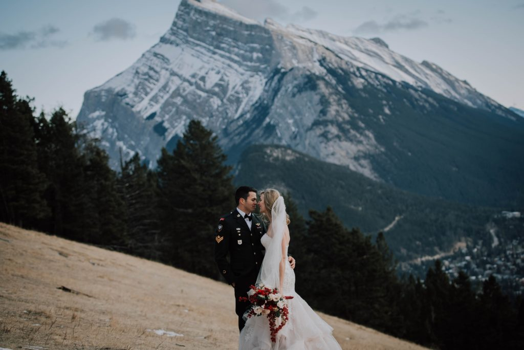 bride and groom embracing during Norquay winter wedding