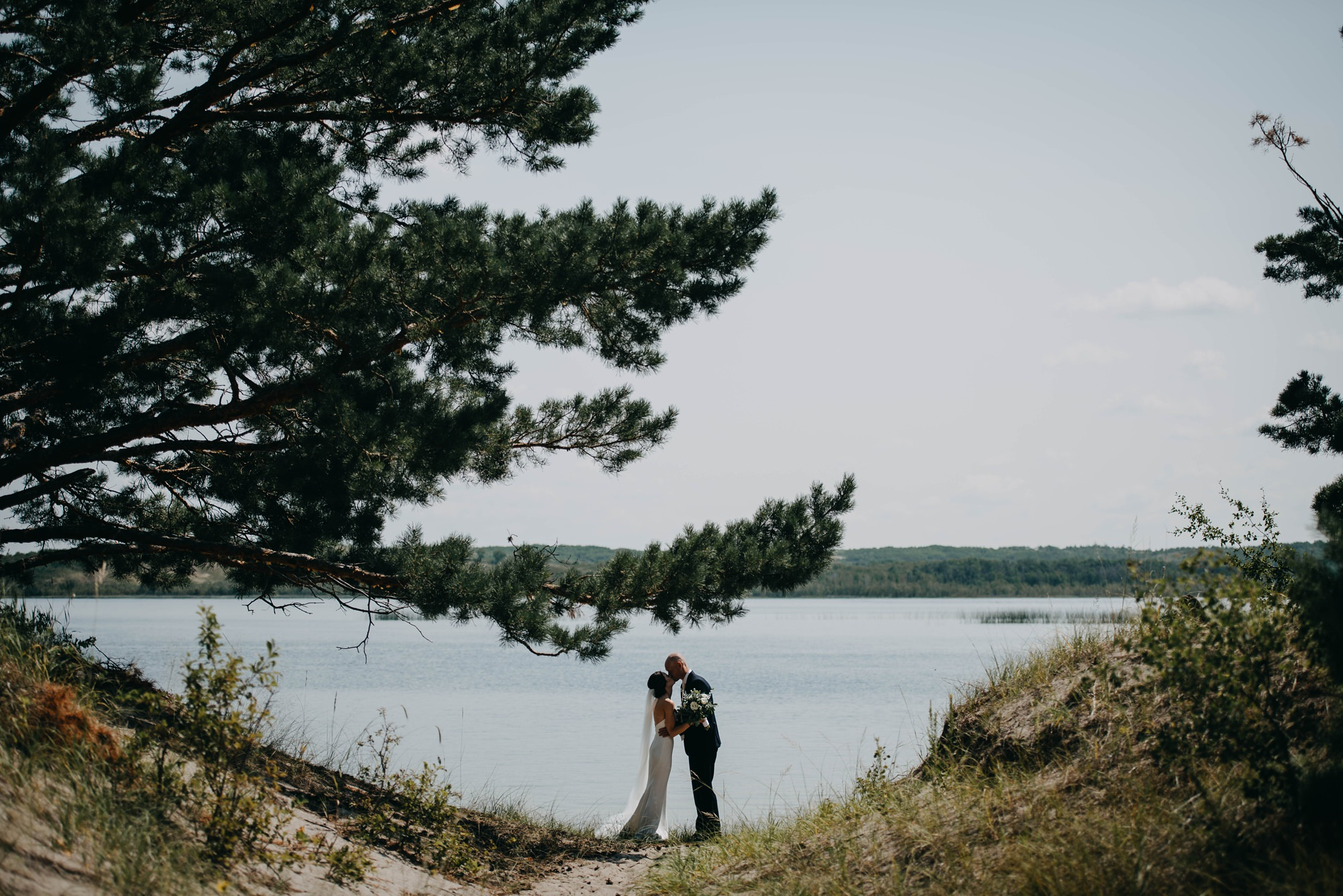 bride and groom bridal portrait in front of lake in farm wedding