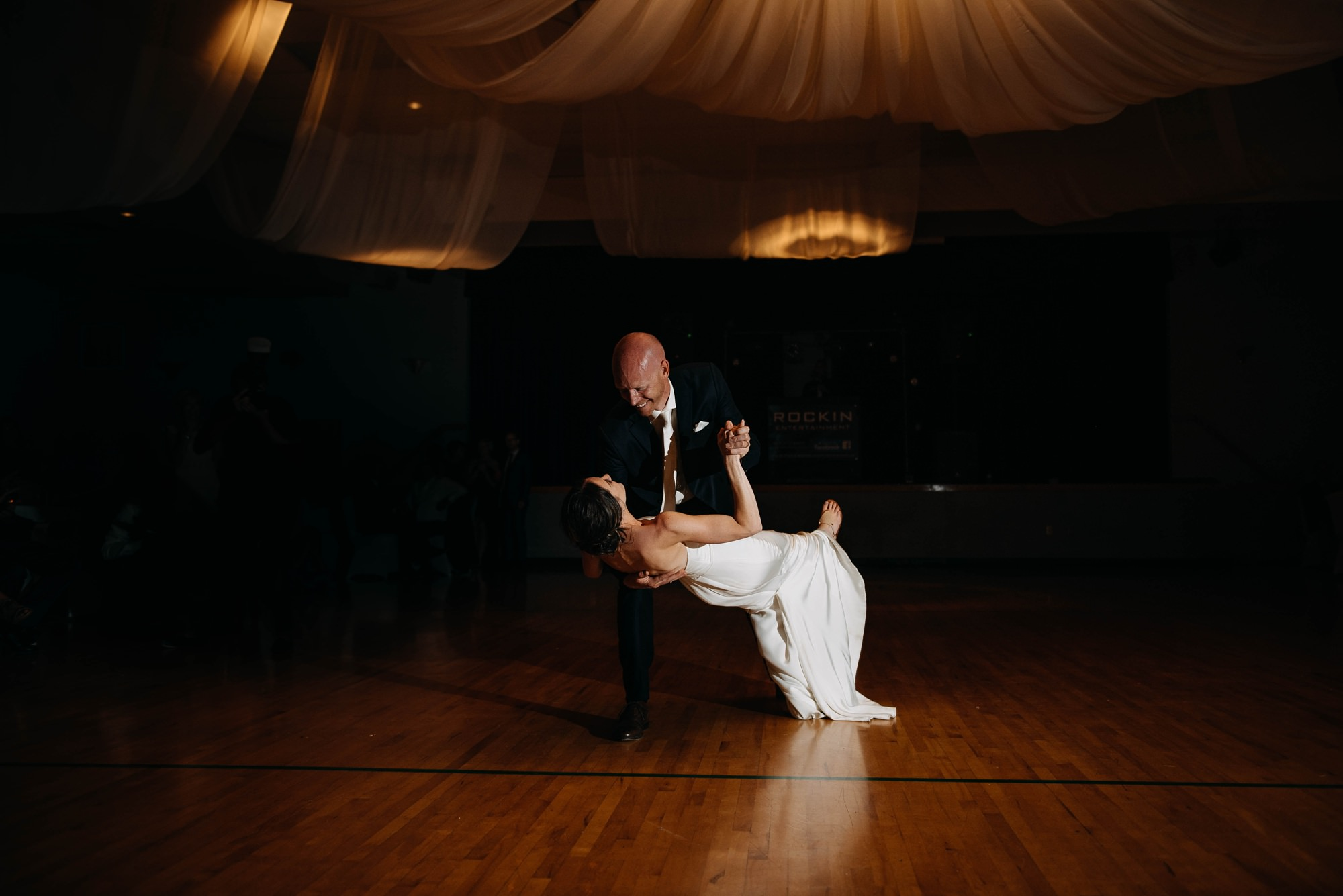 groom dips bride in wedding first dance