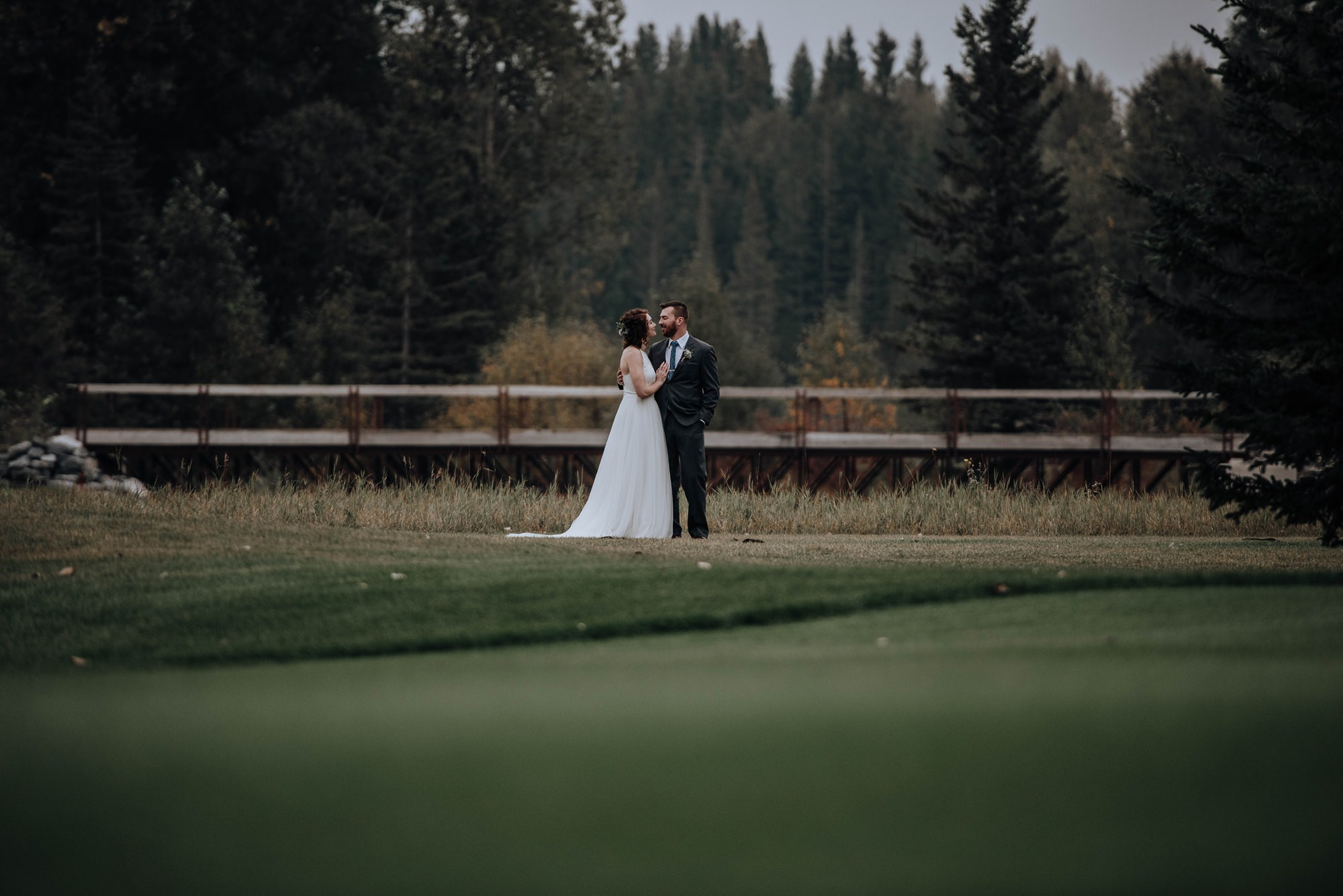 beautiful portraits of bride and groom on a golf course at Calgary golf club wedding in the fall time