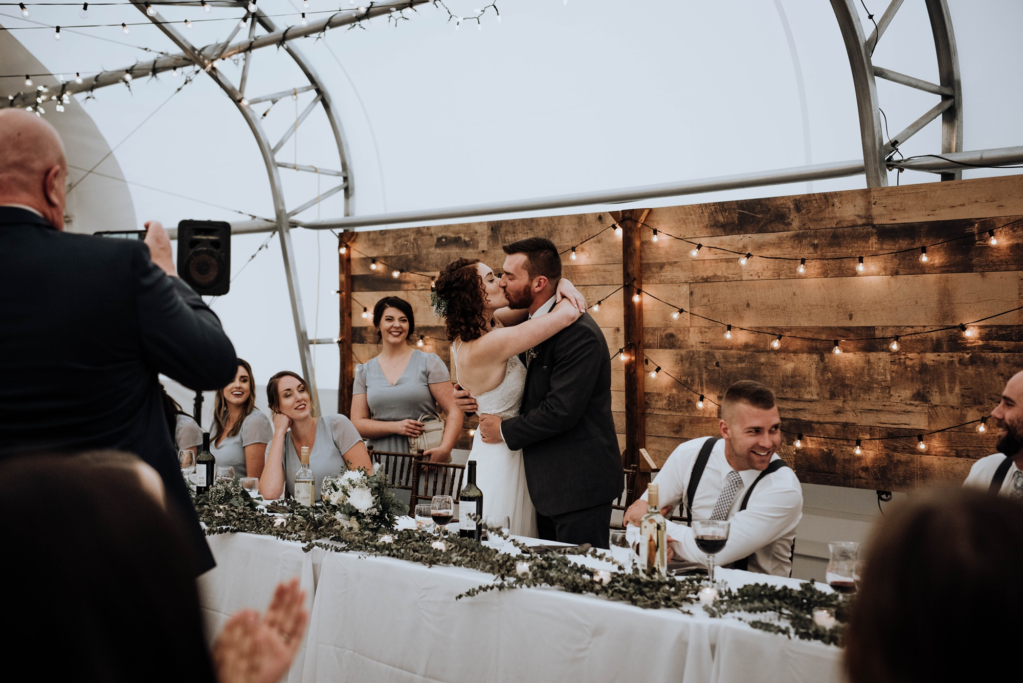 bride and groom perform a song instead of a first dance at run and romantic wedding captured at the river spirit golf course in calgarya