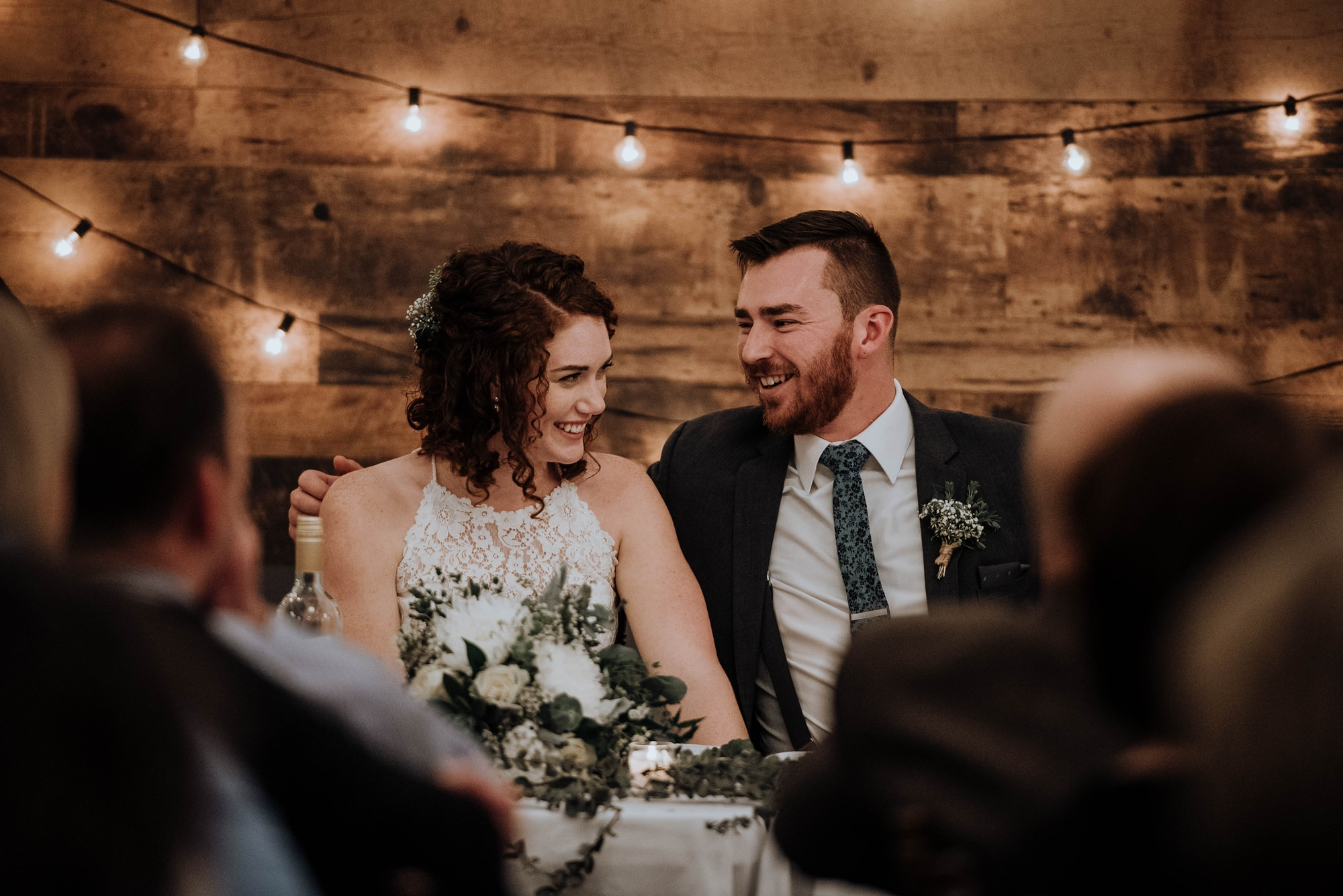 romantic and rustic fall wedding captured at the river spirit golf course
