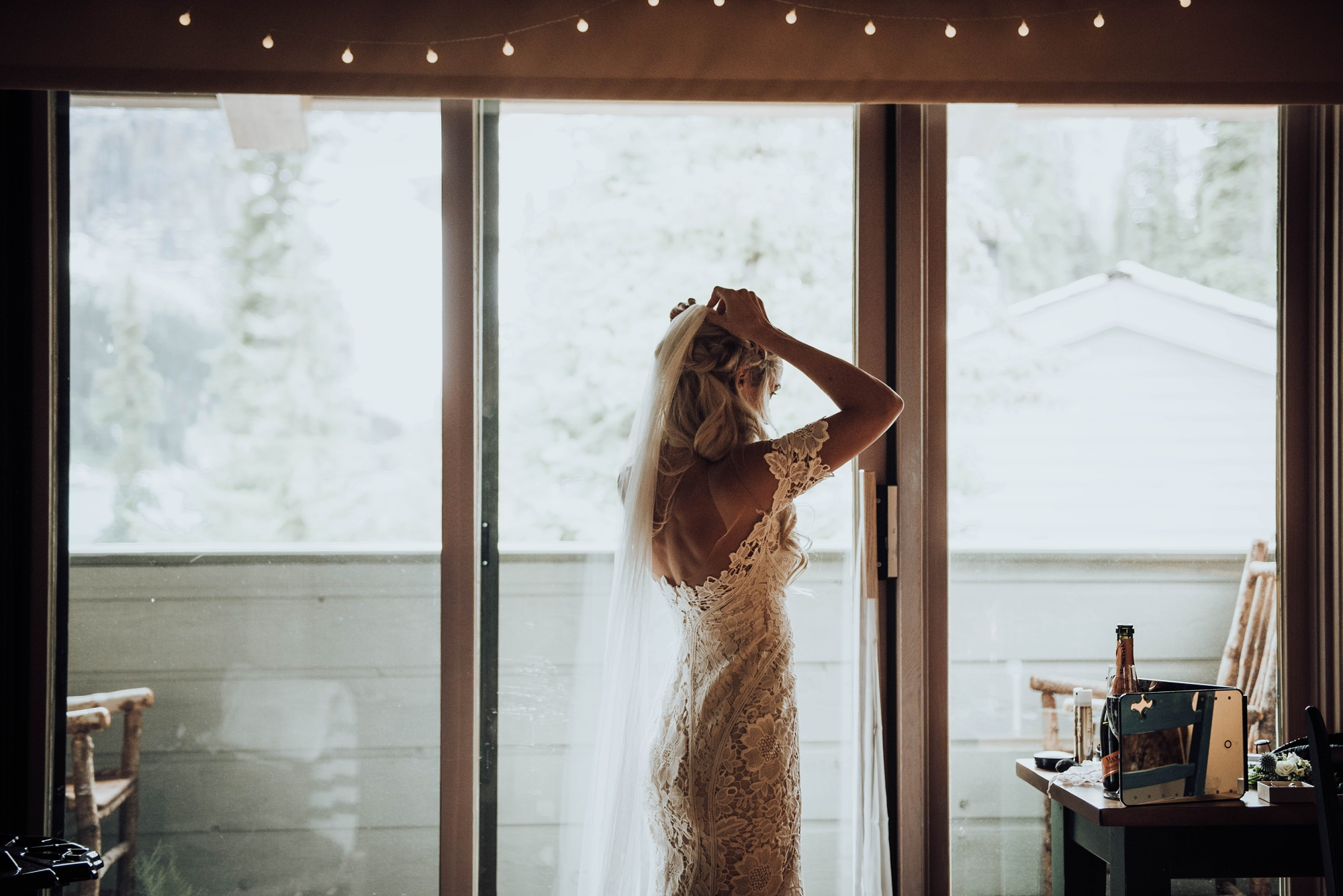 bride getting ready in moody lake louise elopement