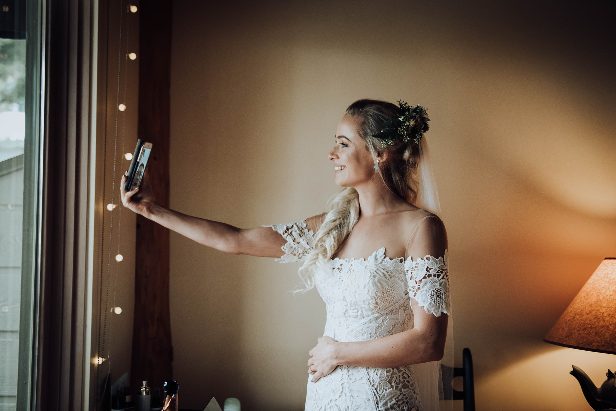 bride getting ready in moody mountain wedding captured at moraine lake lodge and Lake Louise in Banff Canada