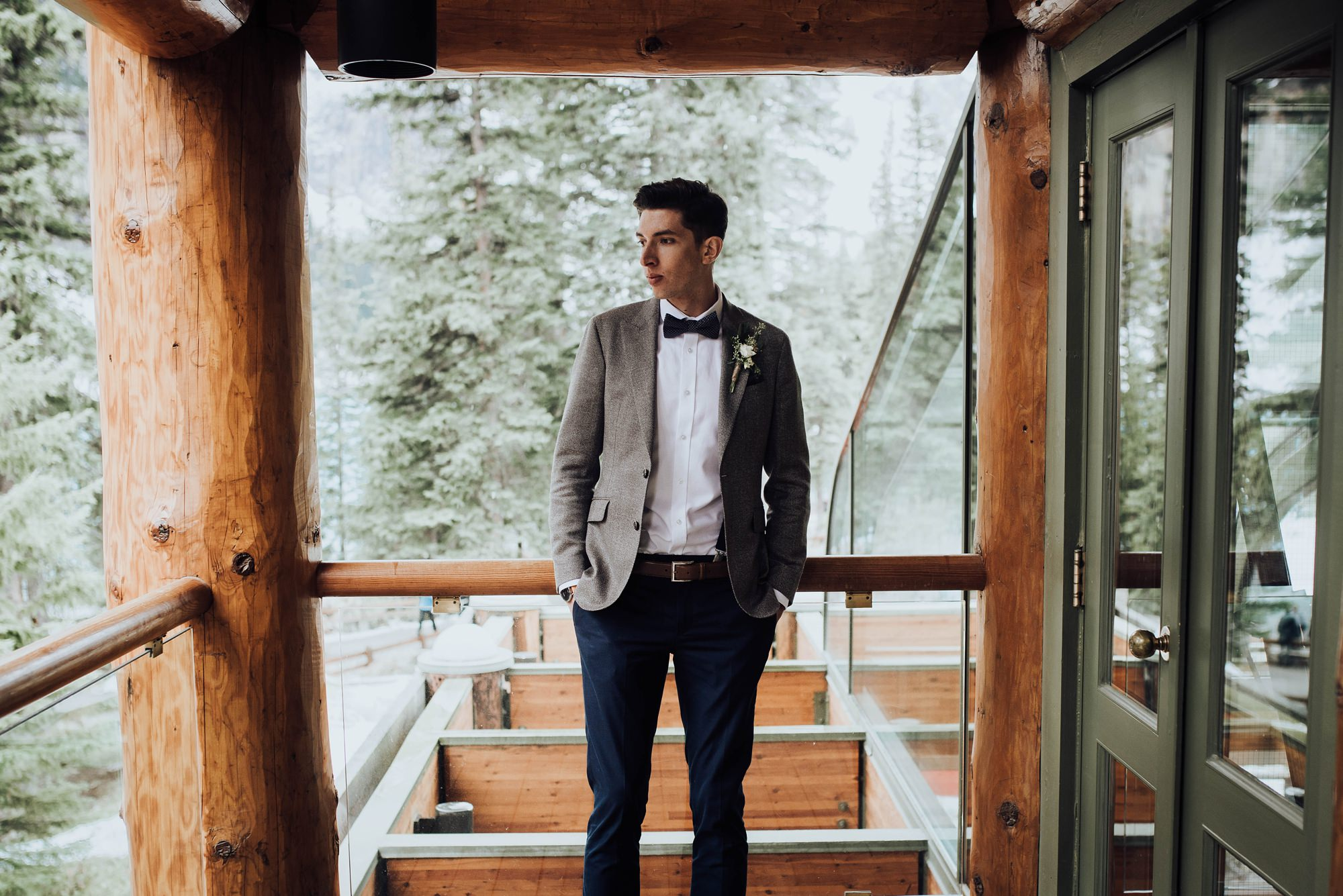 groom getting ready at moraine lake lodge elopement