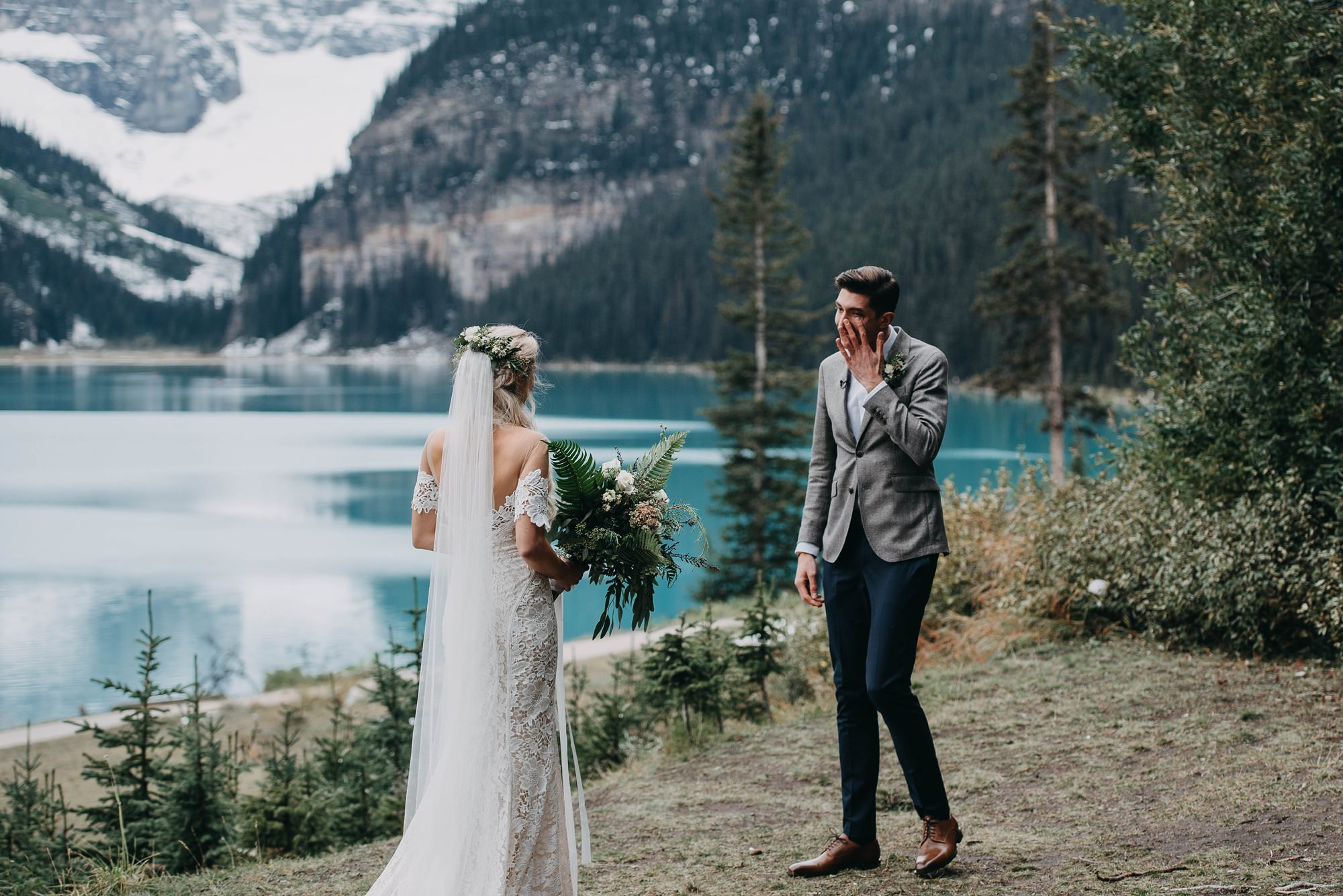 scenic first look between bride and groom at lake louise elopement