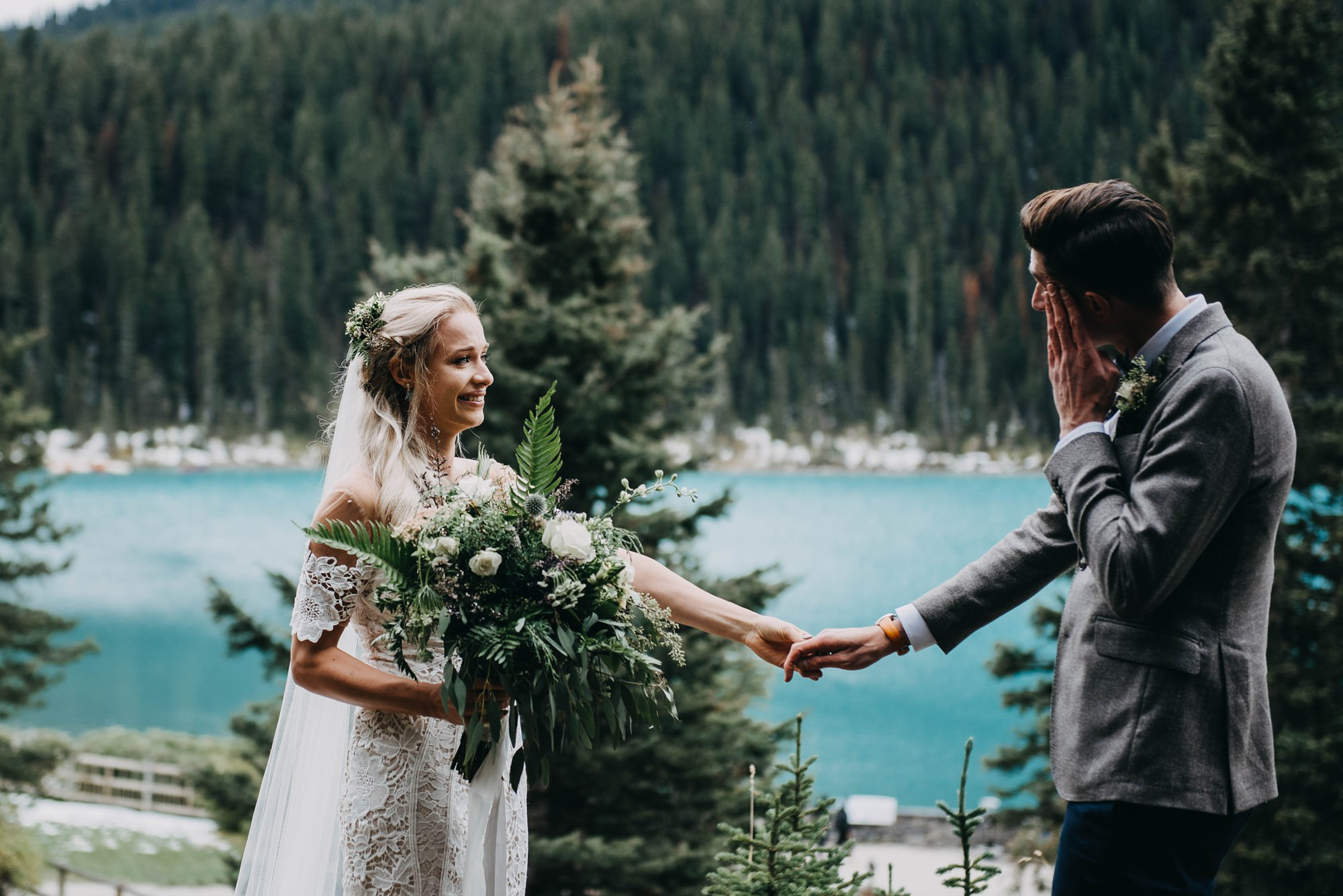 bride and groom first look at lake louise elopement