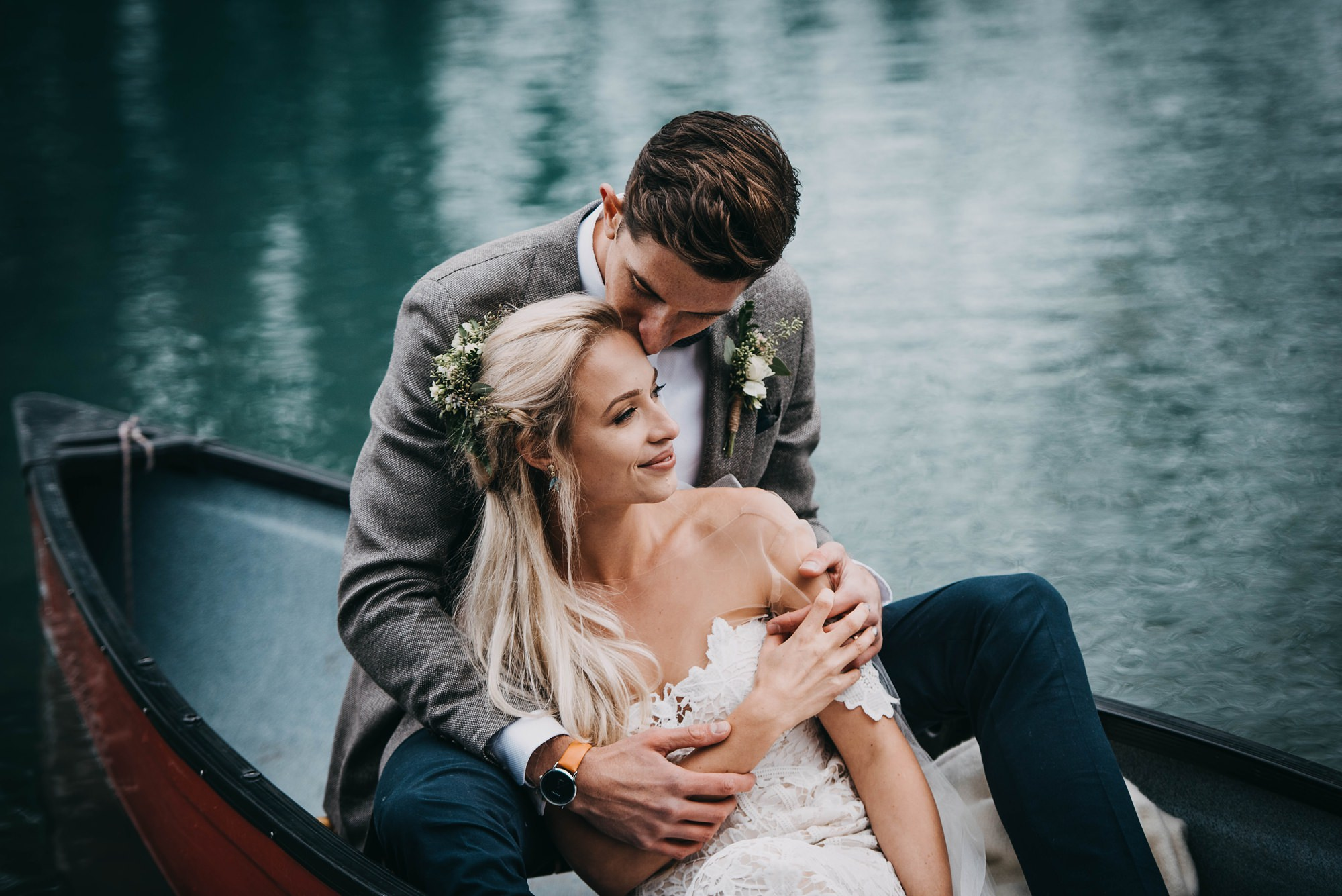 bride and groom in canoe at moraine lake elopement