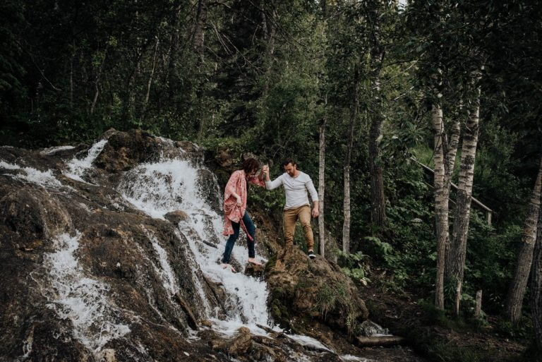 stylish couple in love at waterfall in Big Hill Springs Provincial Park engagement session