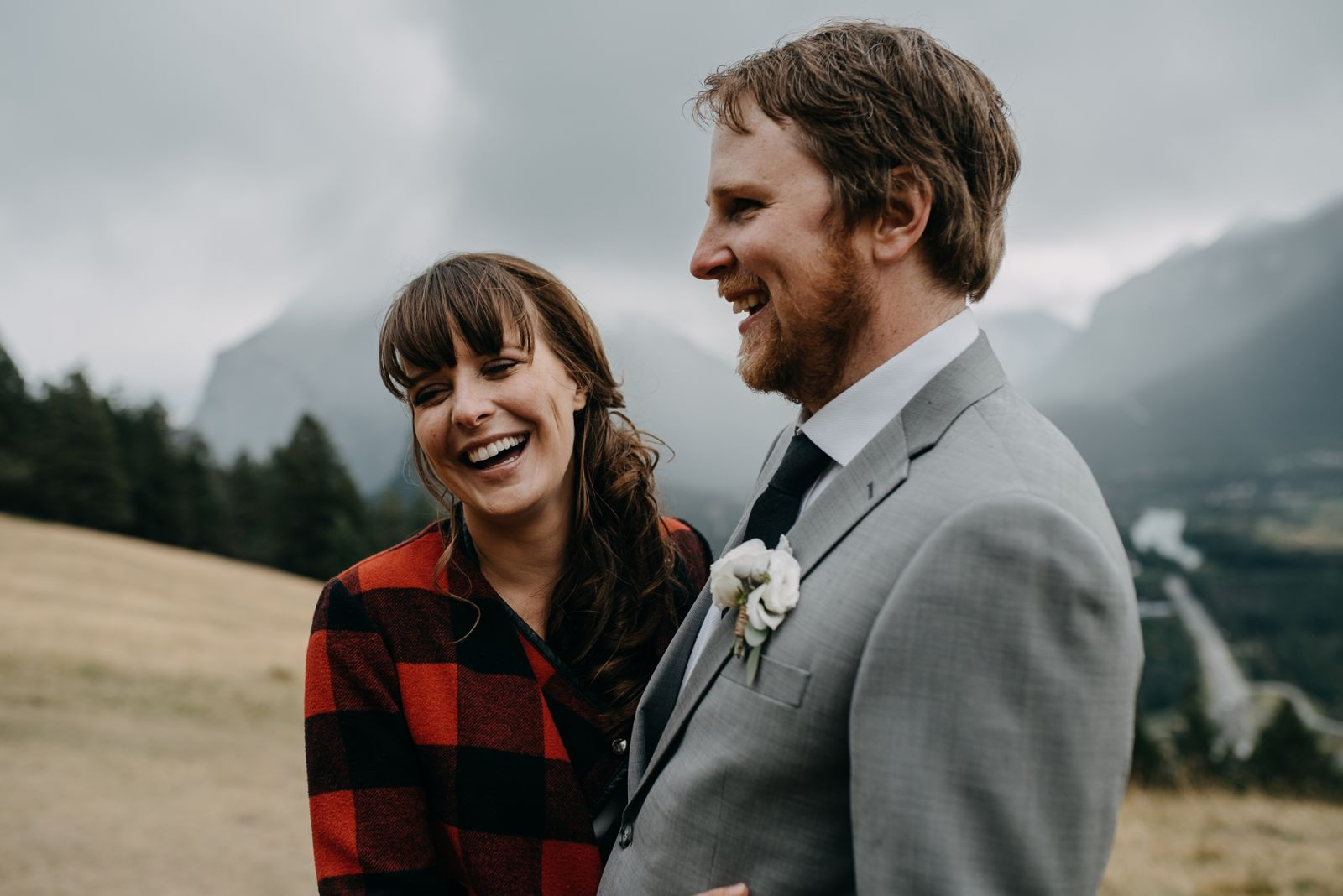 Bride and Groom in boho wedding with indi style bride at Norquay wedding in Banff national park