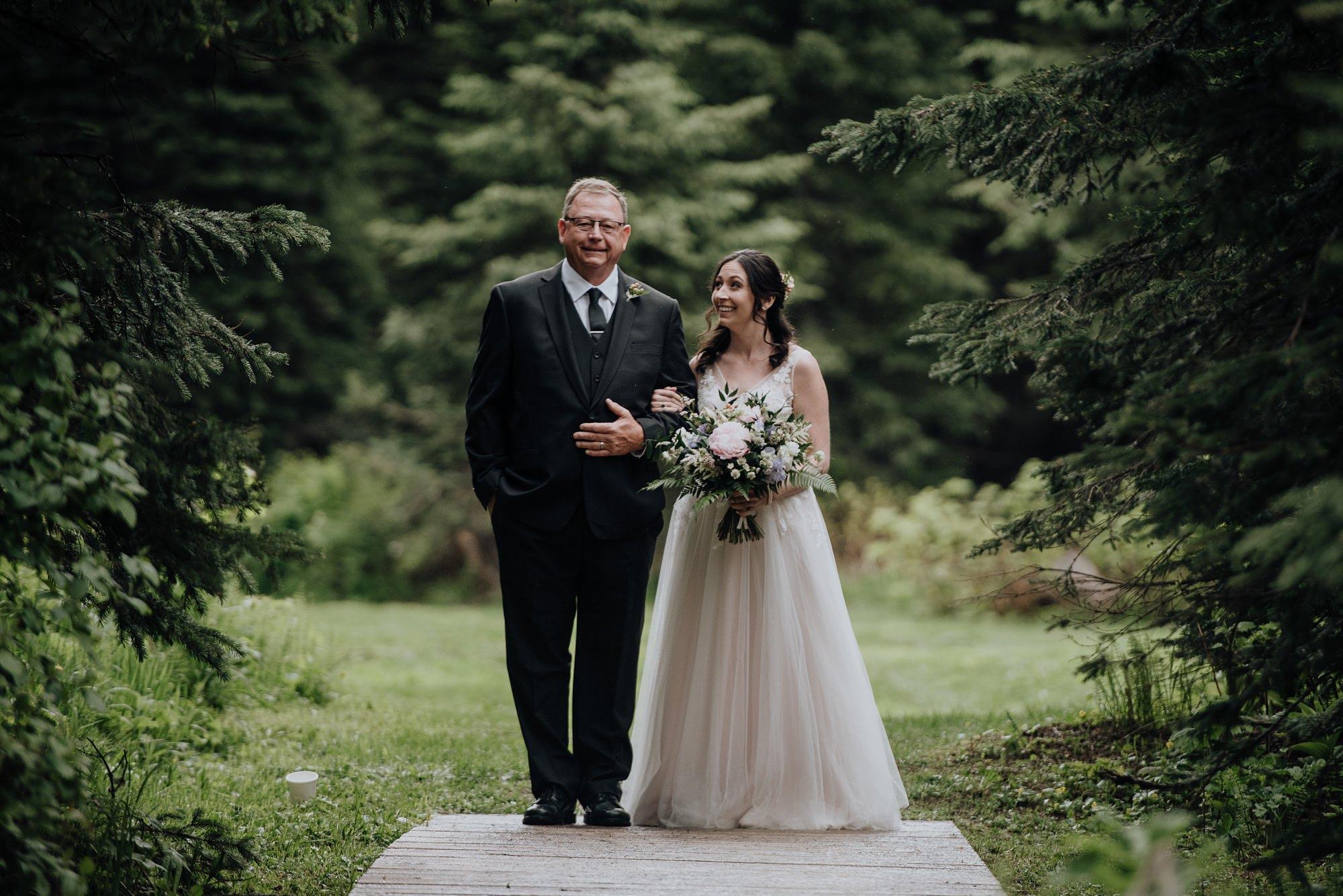 scenic wedding ceremony at island lake lodge wedding