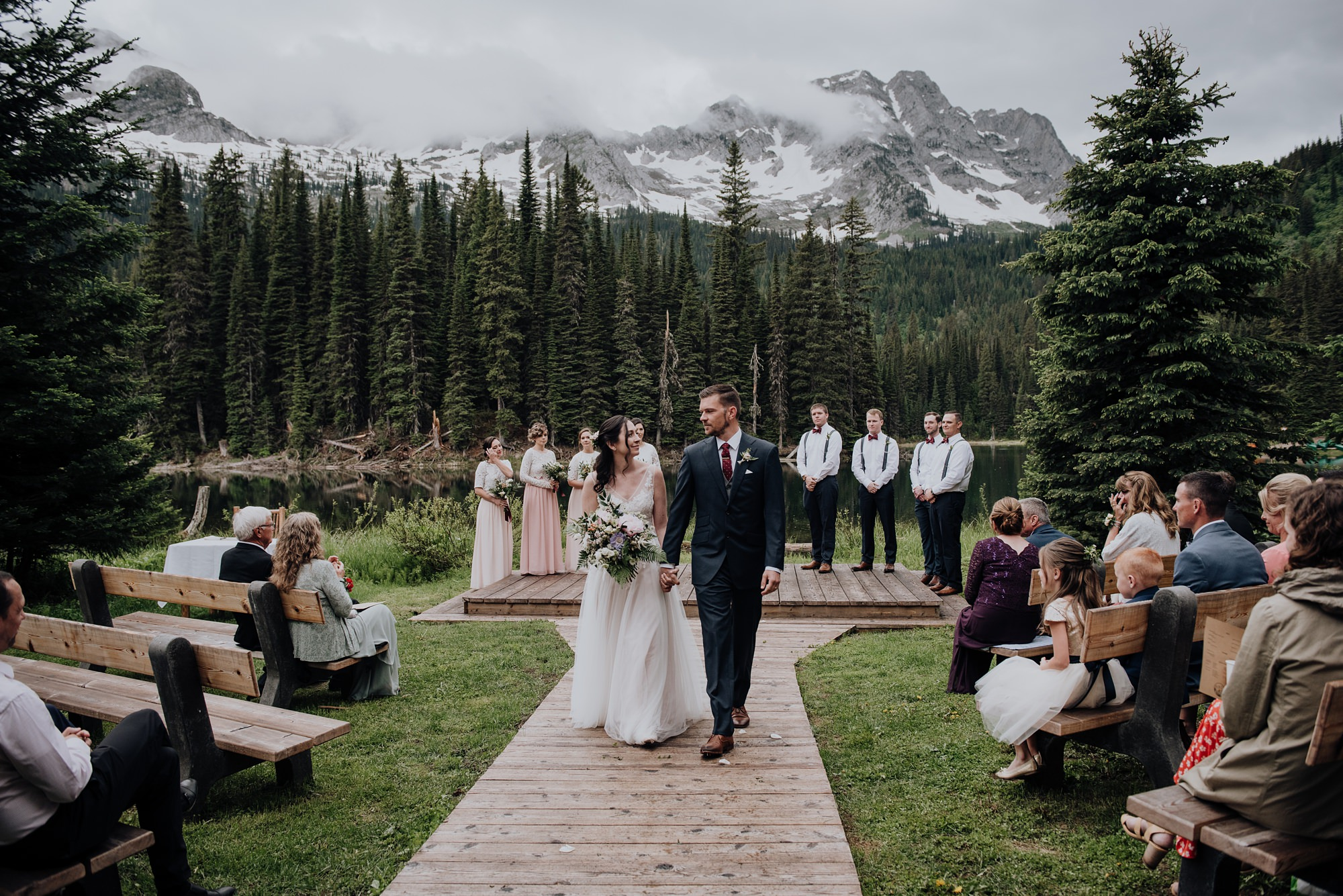 bride and groom during recessional after ceremony with mountain views