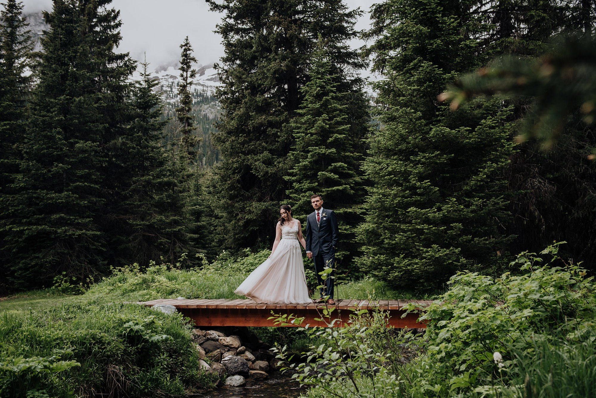 bride and groom in the forest at mountain wedding at the island lake lodge