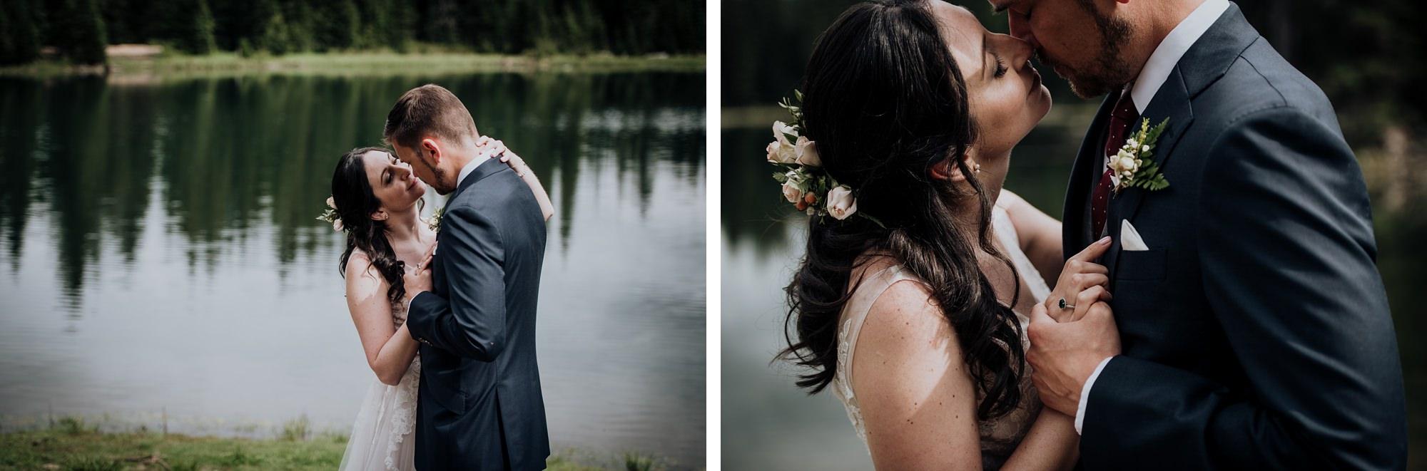 bride and groom at lake during island lake lodge wedding