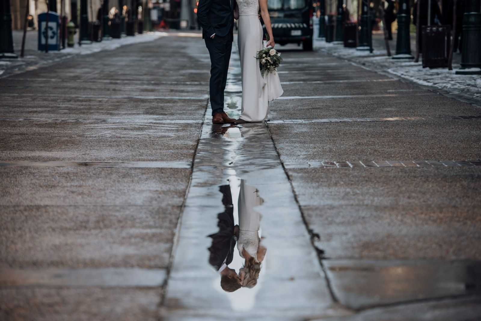 bride and groom in downtown calgary wedding in reflection
