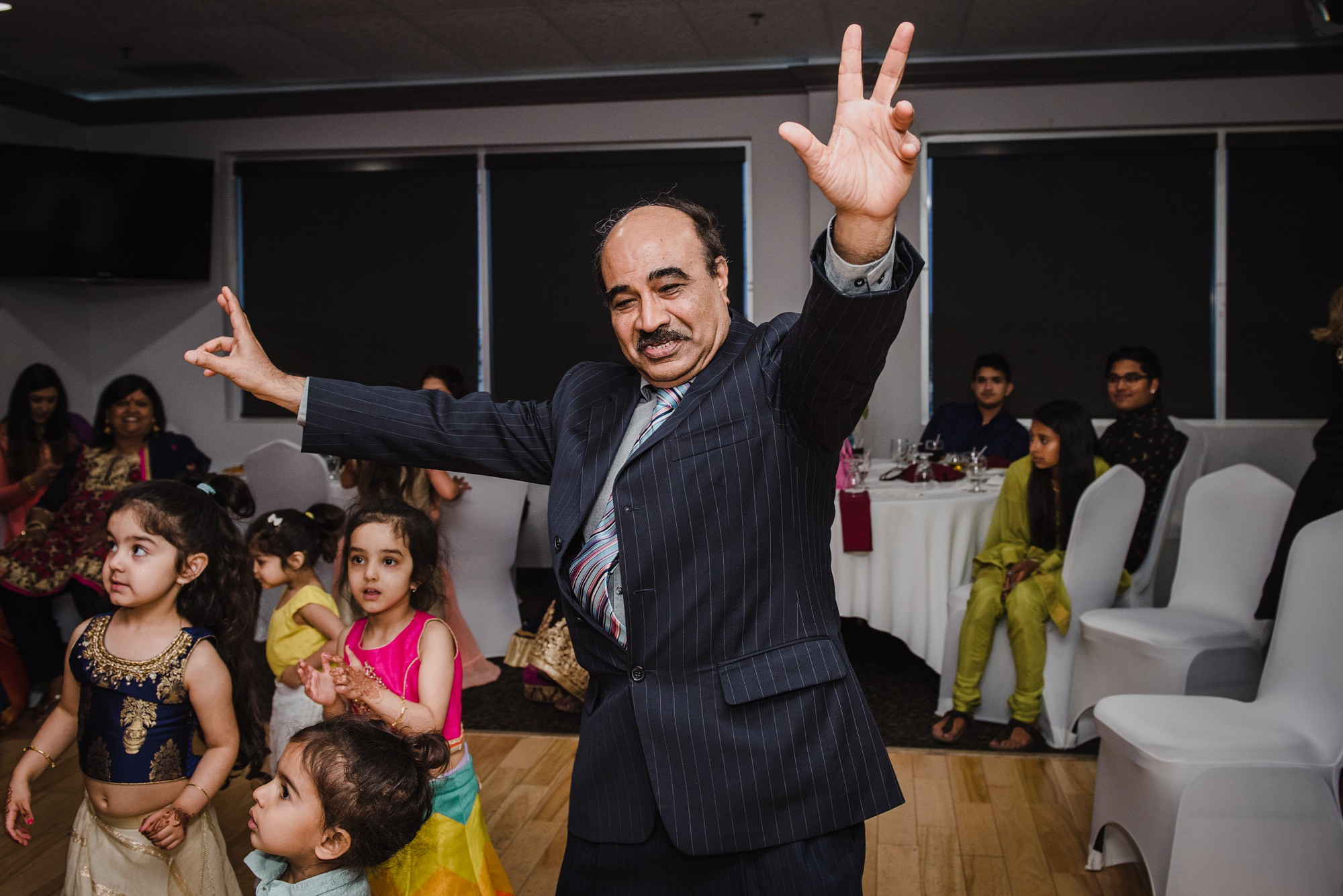 dancing during Sangeet captured by calgary indian wedding photographers