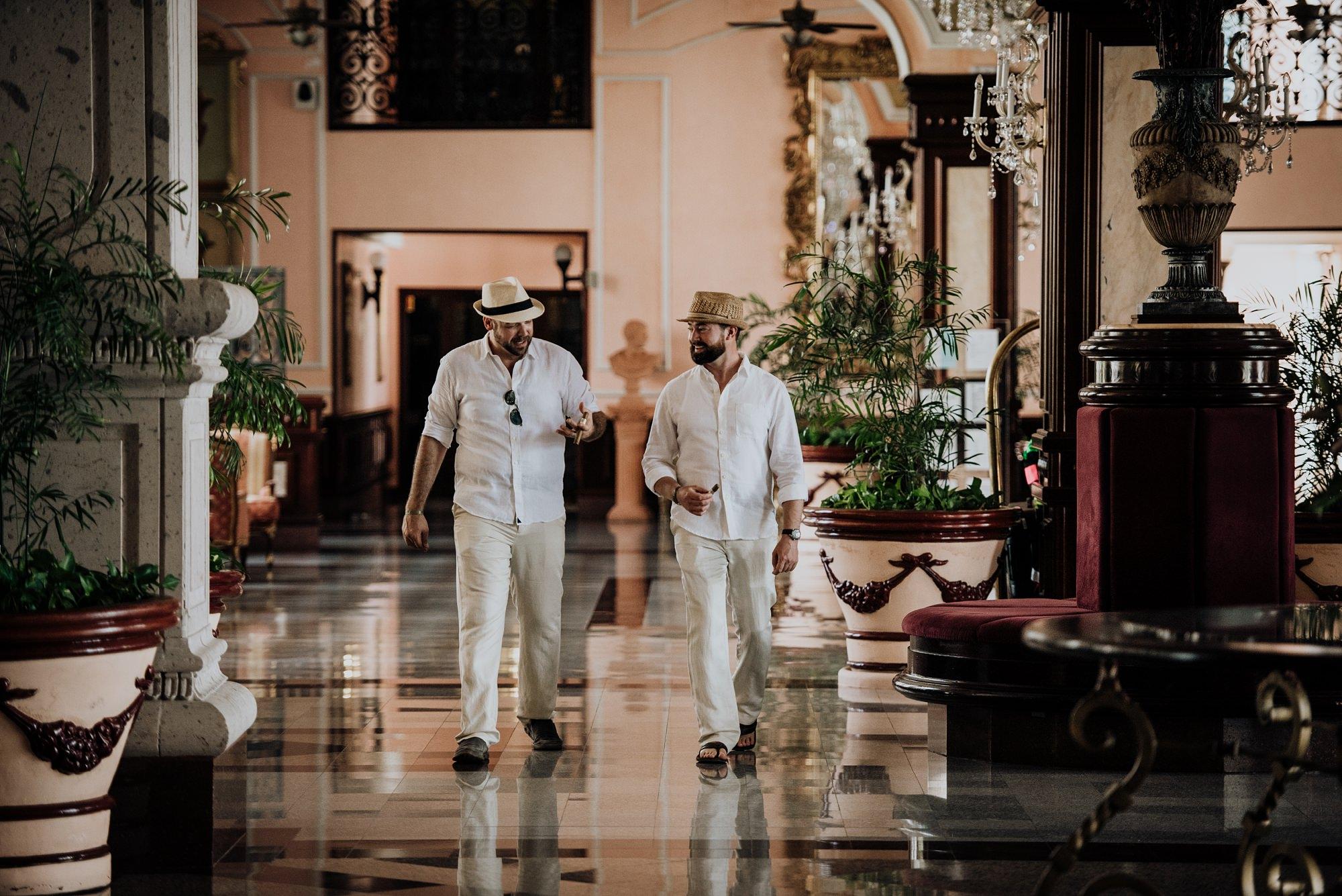 groomsmen walking through hotel at mexico hotel Riu Palace Riviera Maya
