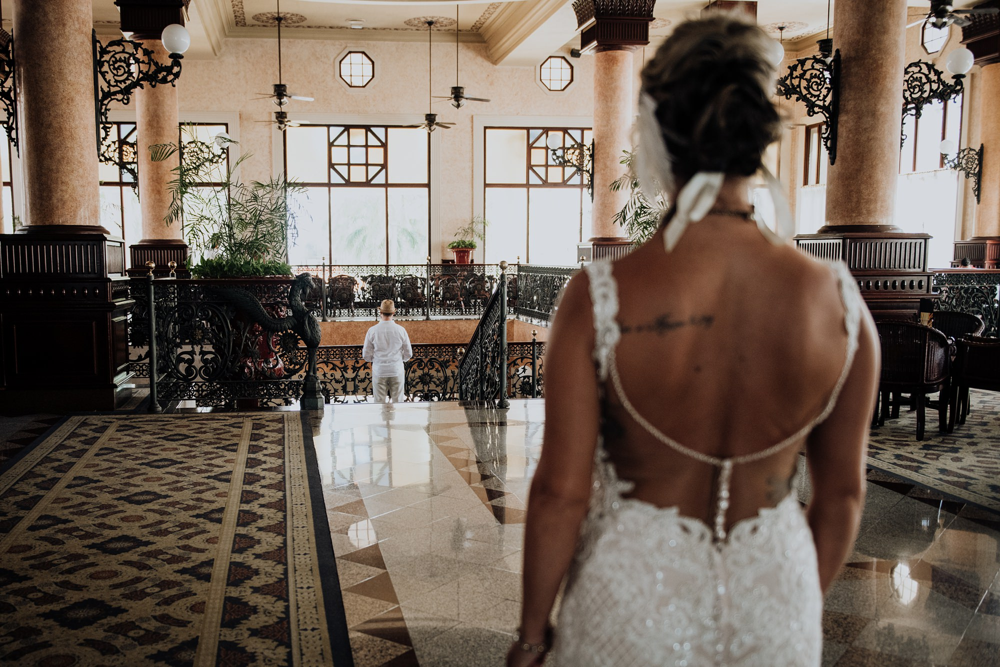 bride and groom first look at mexico hotel Riu Palace Riviera Maya