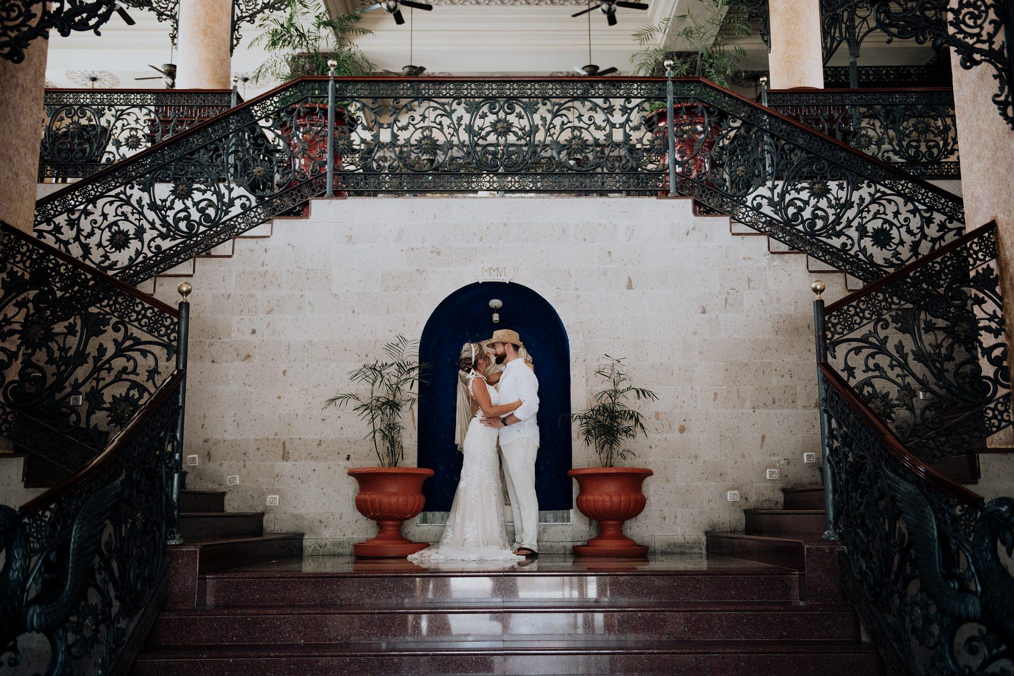 bride and groom in ornate mexico hotel Riu Palace Riviera Maya wedding