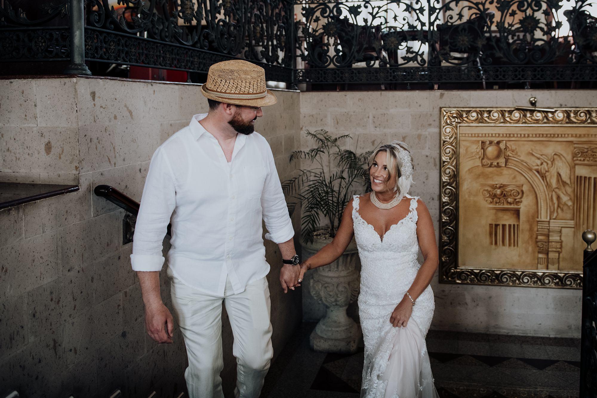 bride and groom walking in foyer at mexico hotel Riu Palace Riviera Maya wedding
