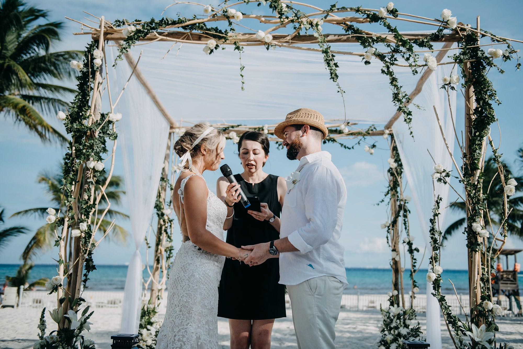 bride and groom vows beach ceremony at mexico hotel Riu Palace Riviera Maya