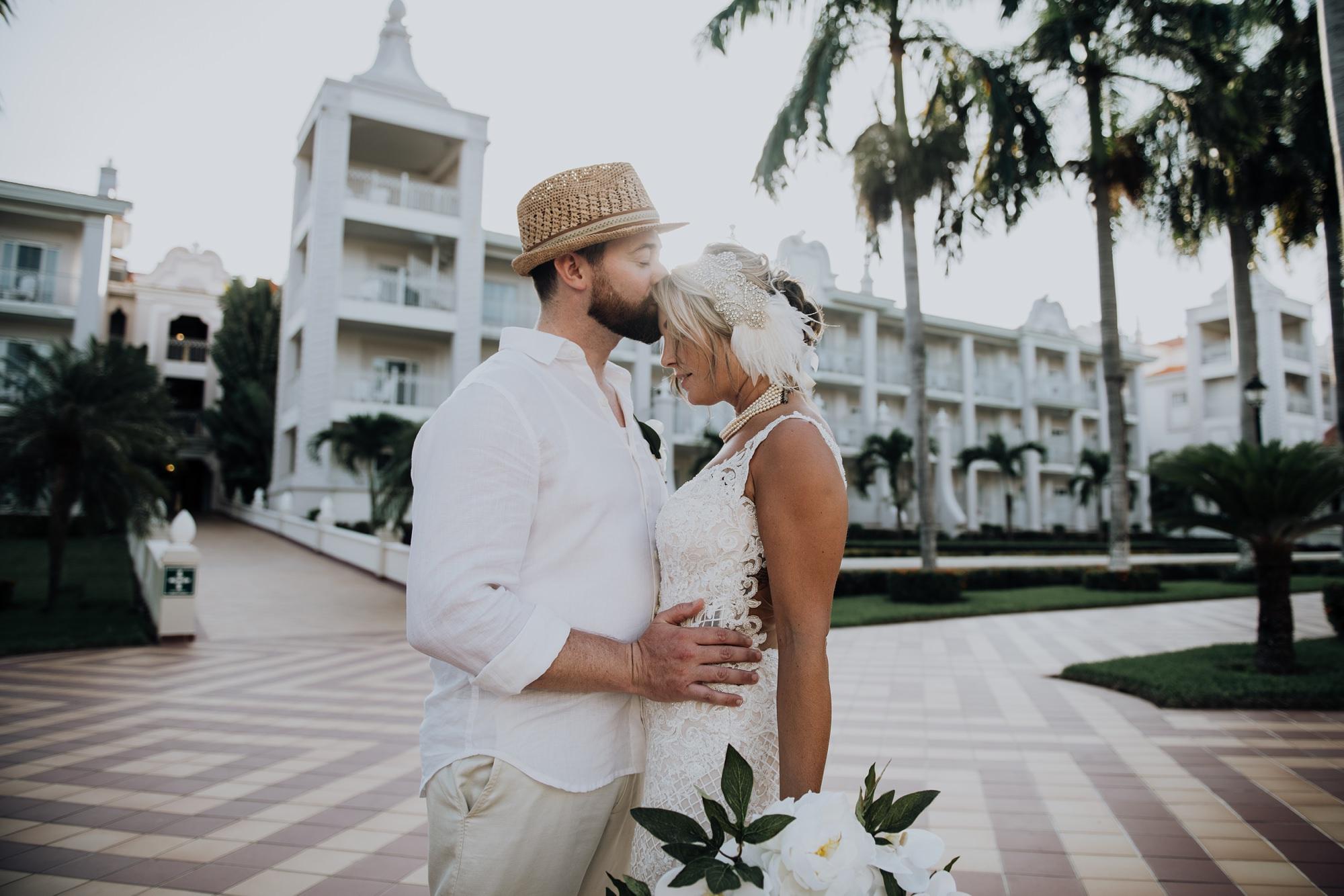 bride and groom kiss Riu Palace Riviera Maya hotel