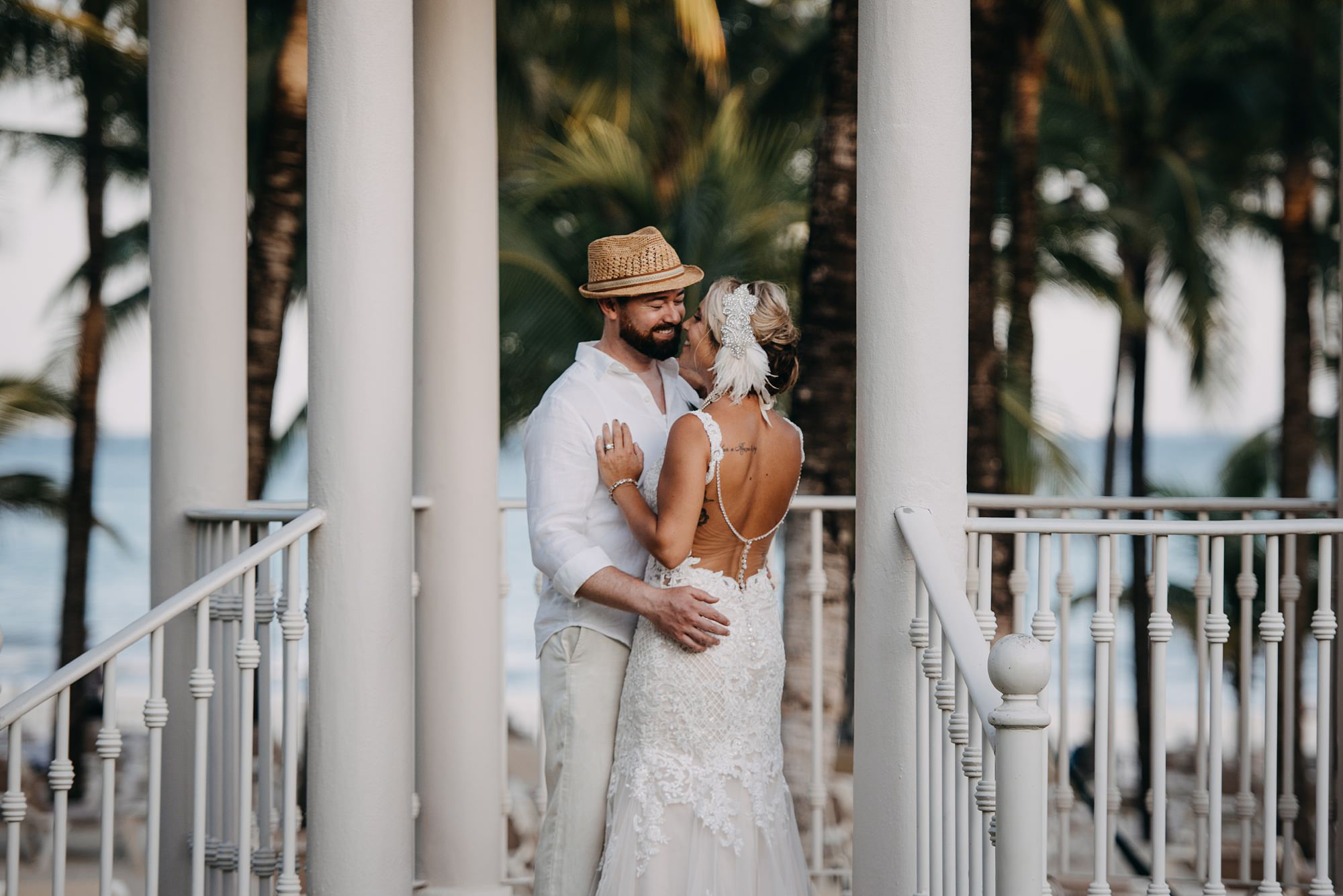 bride and groom laughing at beach Riu Palace Riviera Maya wedding