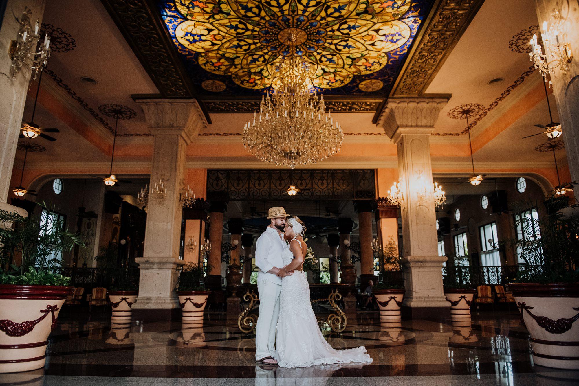 bride and groom at ornate hotel reception in mexico at Riu Palace Riviera Maya