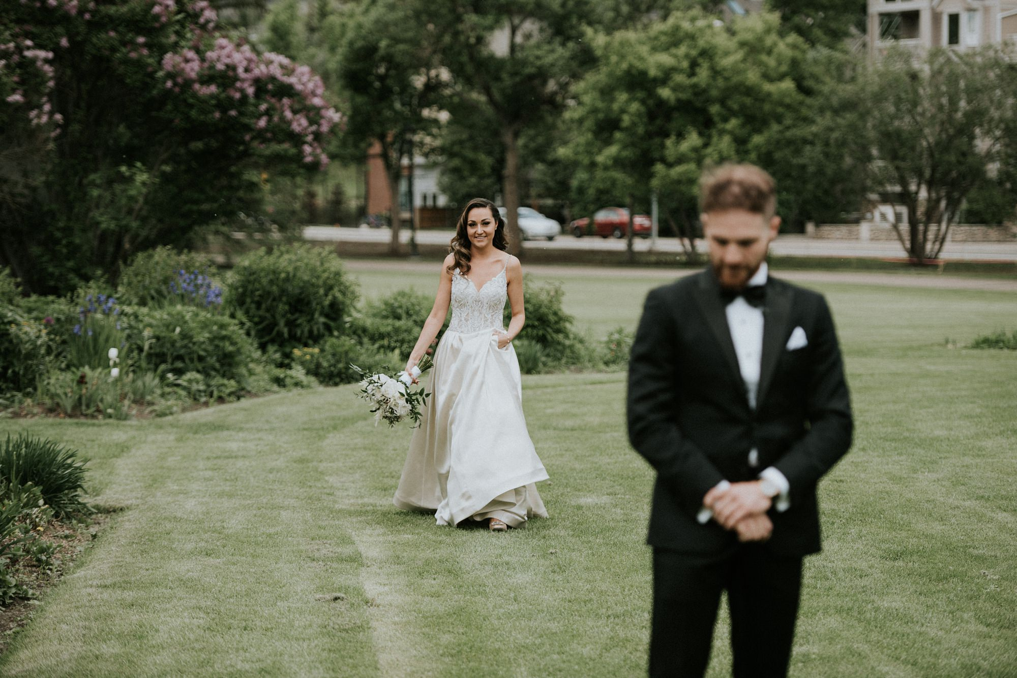 bride and groom at riley park in calgary wedding sharing first look