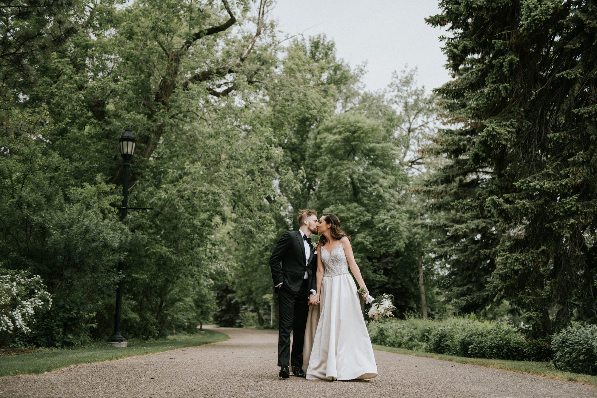 bride and groom walking in riley park in downtown calgary wedding