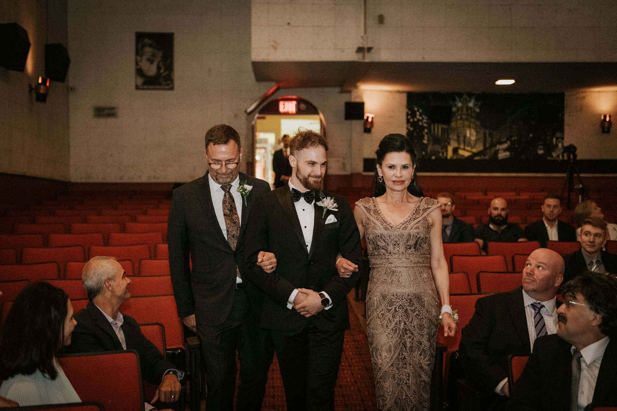 groom and bride walking up the isle during plaza theatre wedding