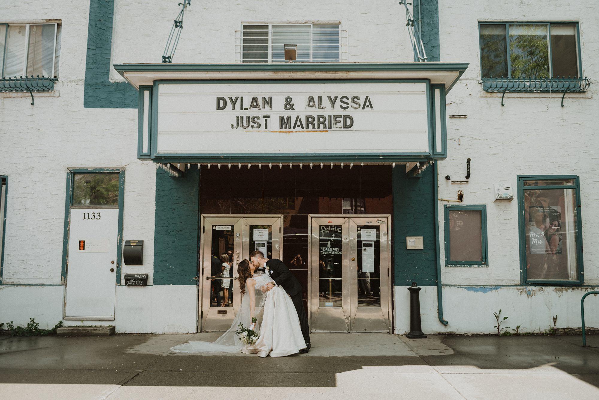 stylish bride and groom in plaza theatre wedding in kensington, calgary