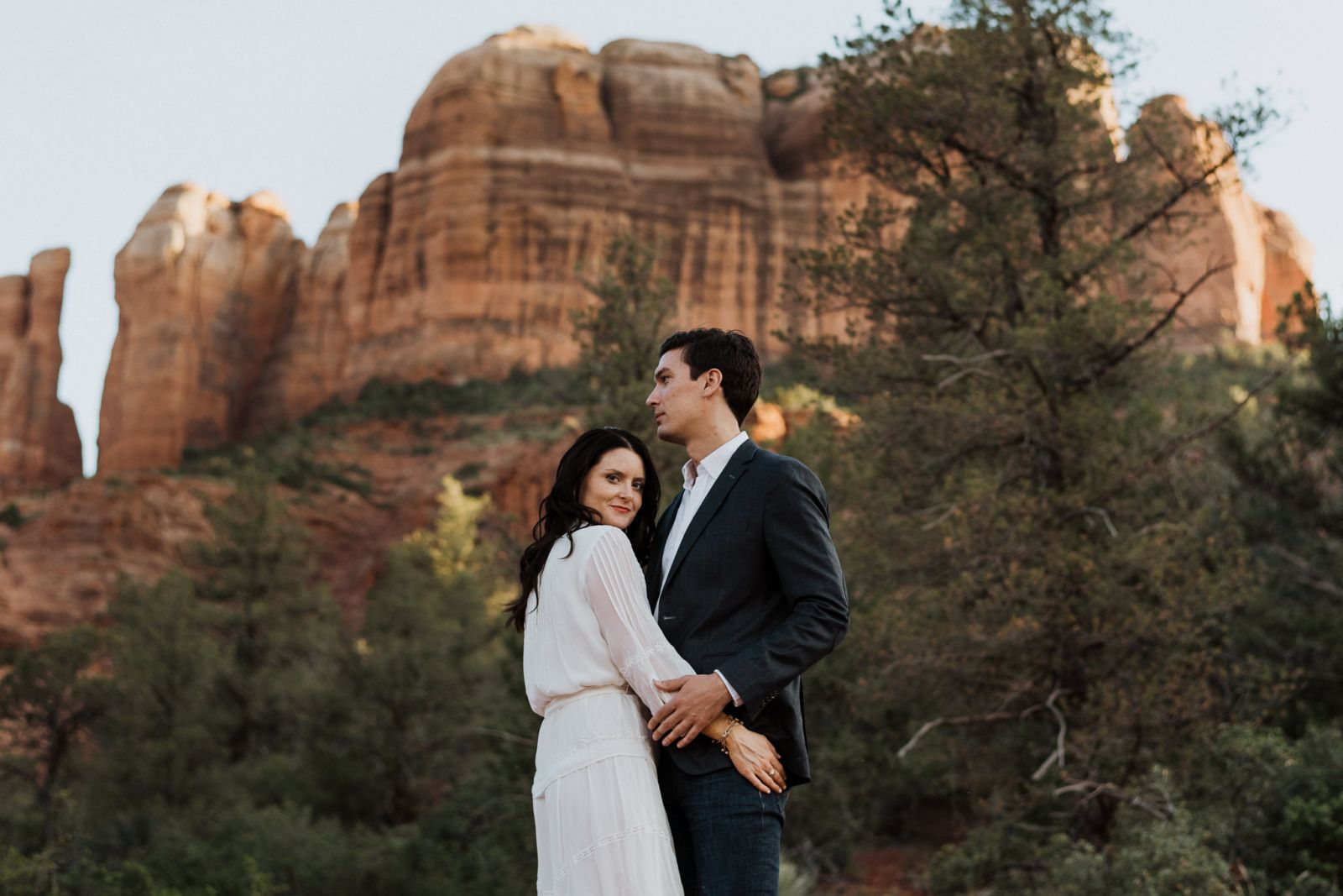 bride and groom in at castle rock in arizona