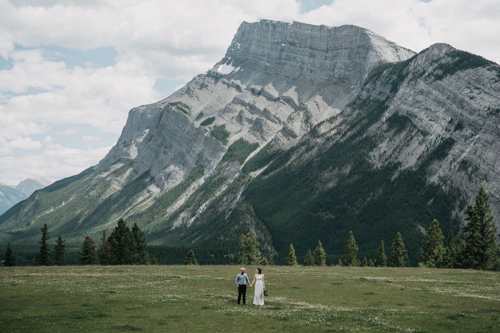 bride and groom at tunnel mountain meadow wedding in banff elopement