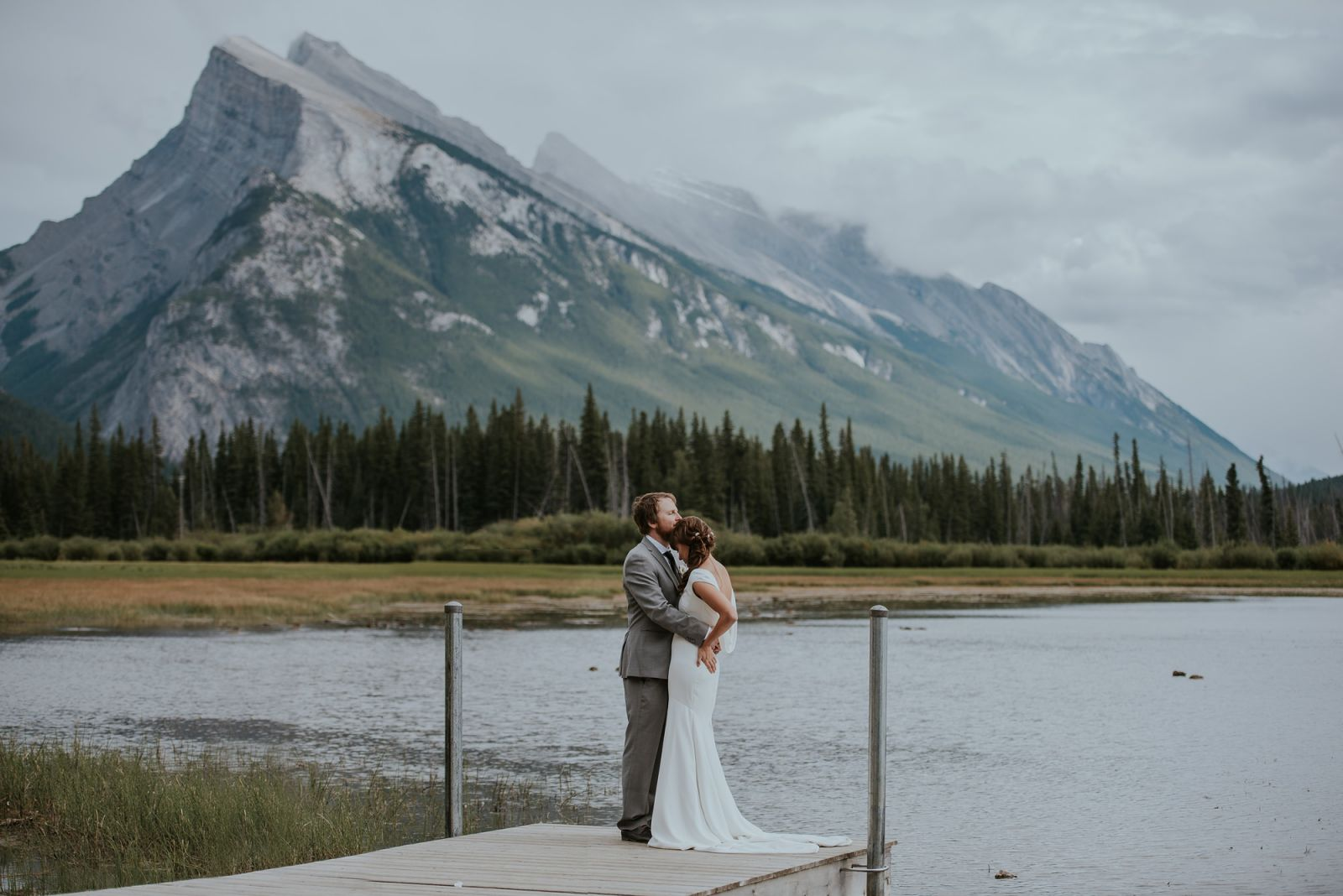 bride and groom at vermillion lakes in banff national park
