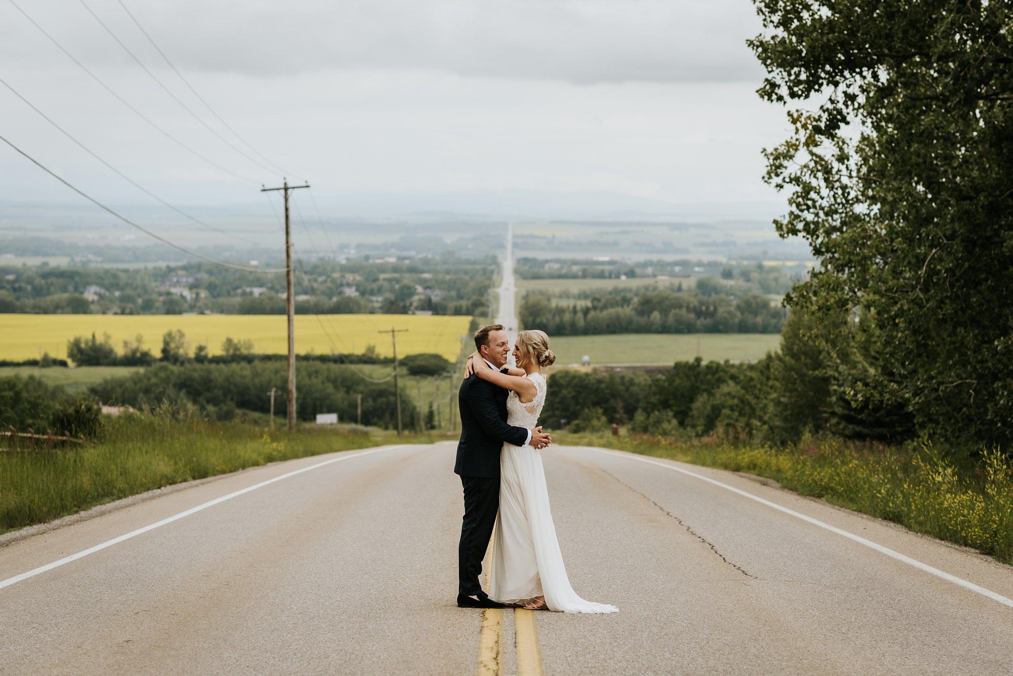 bride and groom embracing in alloy restaurant wedding in calgary