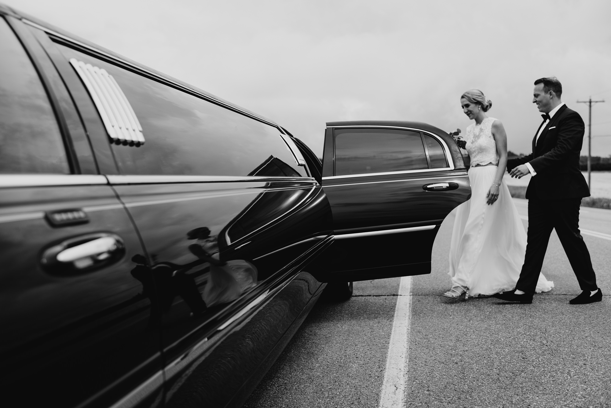 bride and groom in wedding limo picture