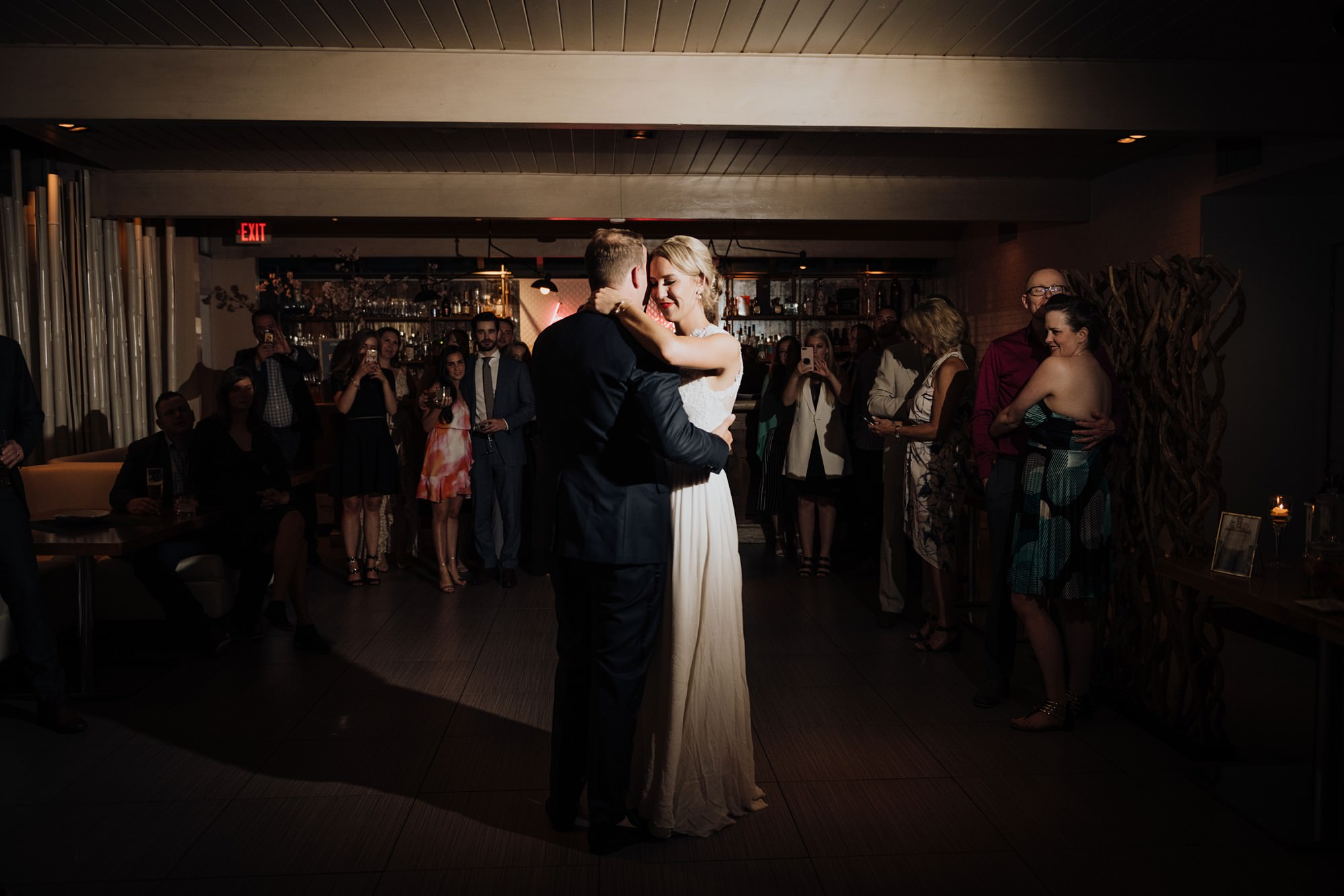 bride and groom share first dance at alloy restaurant wedding