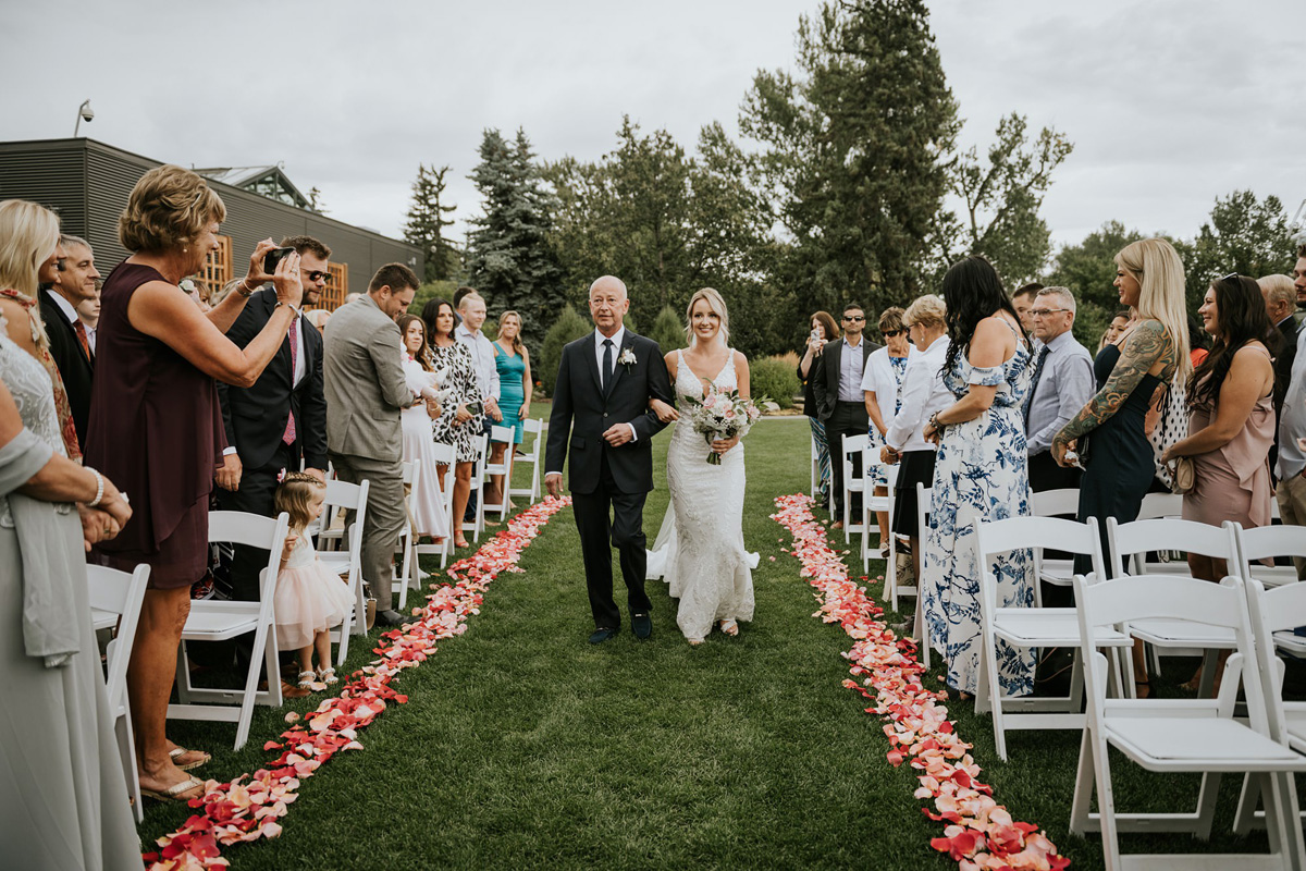 bride and father walking up the isle at outdoor ceremony