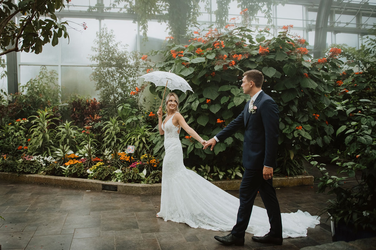 bride and groom in butterfly sanctuary in calgary zoo